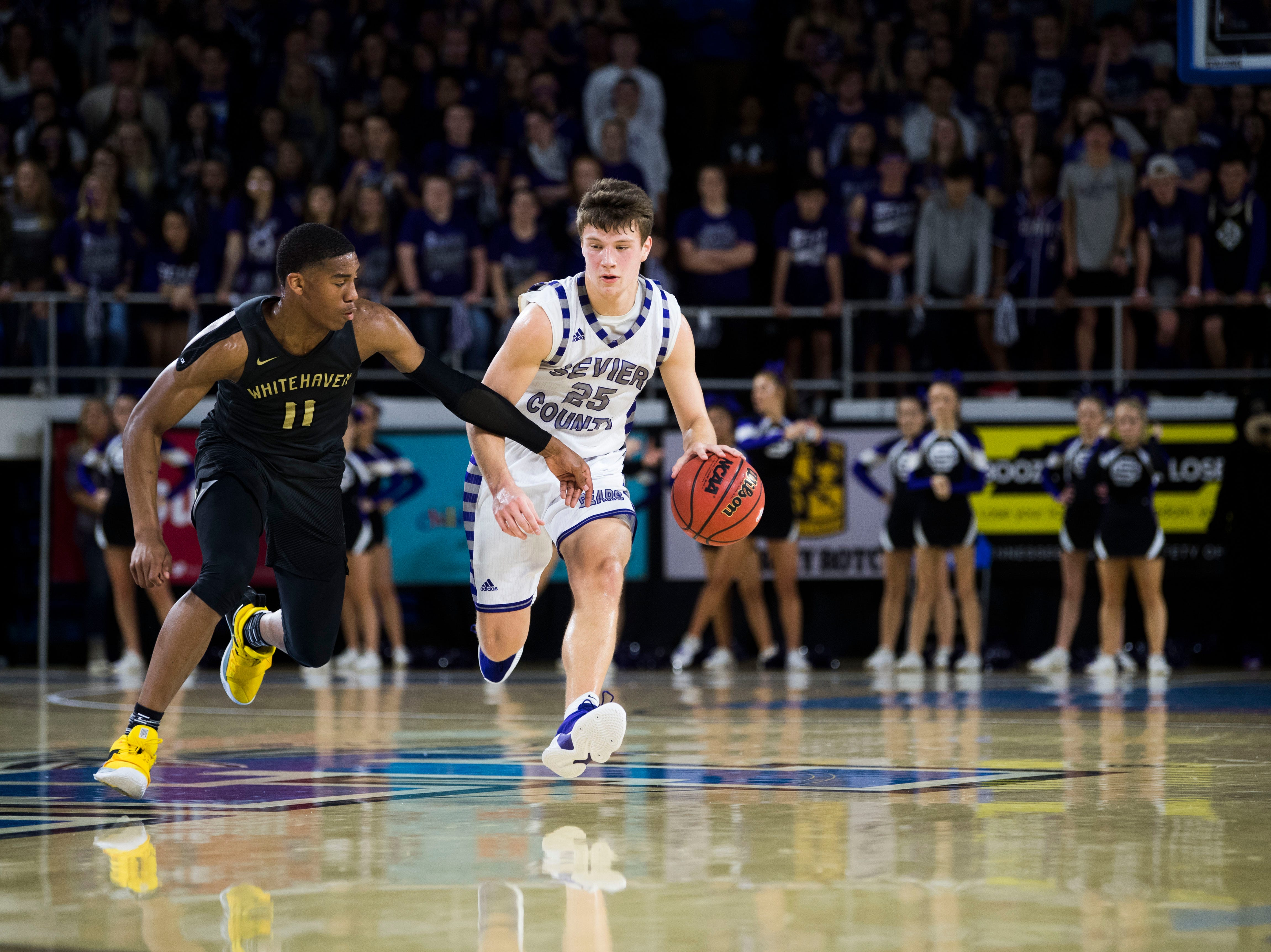 Sevier County's Camden McElhaney (25) drives down the court while defended by Whitehaven's Matthew Murrell (11) during a TSSAA AAA state quarterfinal game between Sevier County and Whitehaven at the Murphy Center in Murfreesboro, Wednesday, March 13, 2019.