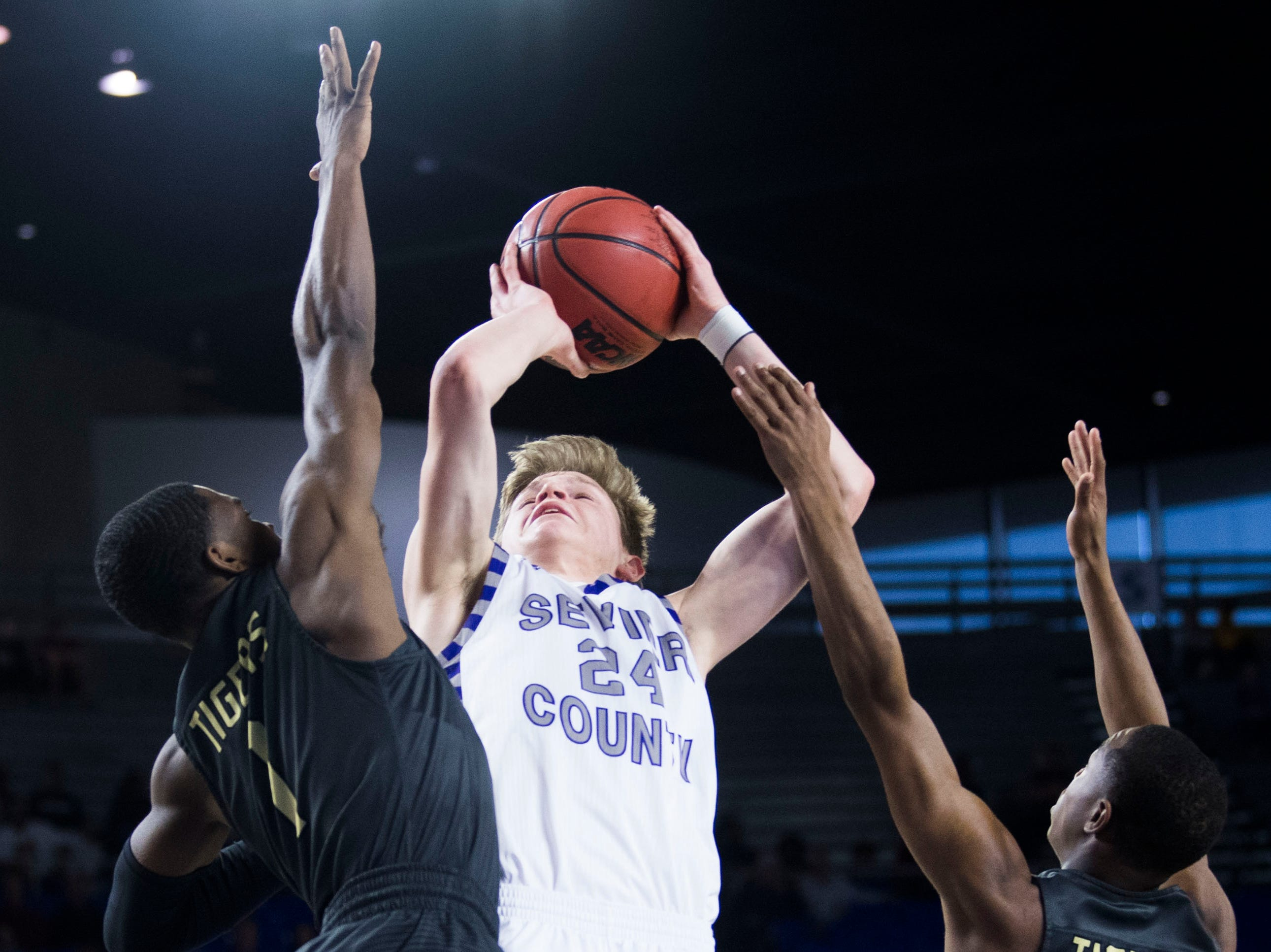 Sevier County's Wesley Maples (24) takes a shot during a TSSAA AAA state quarterfinal game between Sevier County and Whitehaven at the Murphy Center in Murfreesboro, Wednesday, March 13, 2019.