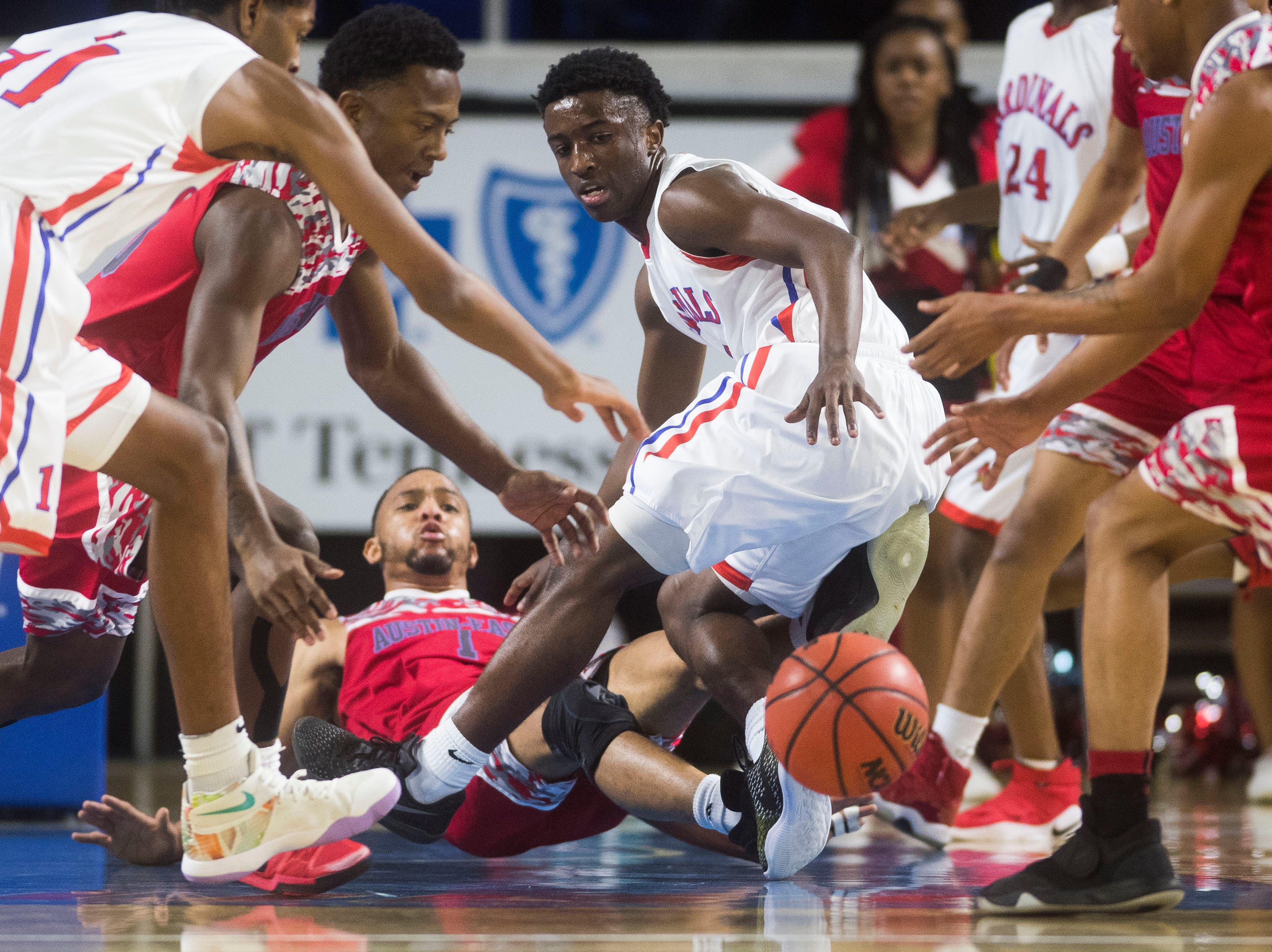 Players scramble for the ball during a TSSAA AA state quarterfinal game between Austin-East and Wooddale at the Murphy Center in Murfreesboro, Wednesday, March 13, 2019.