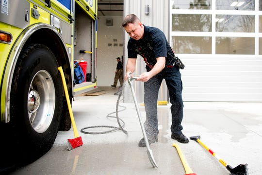 Firefighter Evan McCullan cleans off equipment after returning from a fire call at the new Rural Metro Fire Station 36, 7615 Norman Jack Lane, in Powell, Tennessee on Wednesday, March 13, 2019. The station has been operational since early February and is hosting an open house and grand opening March 14 from 10am-7pm.