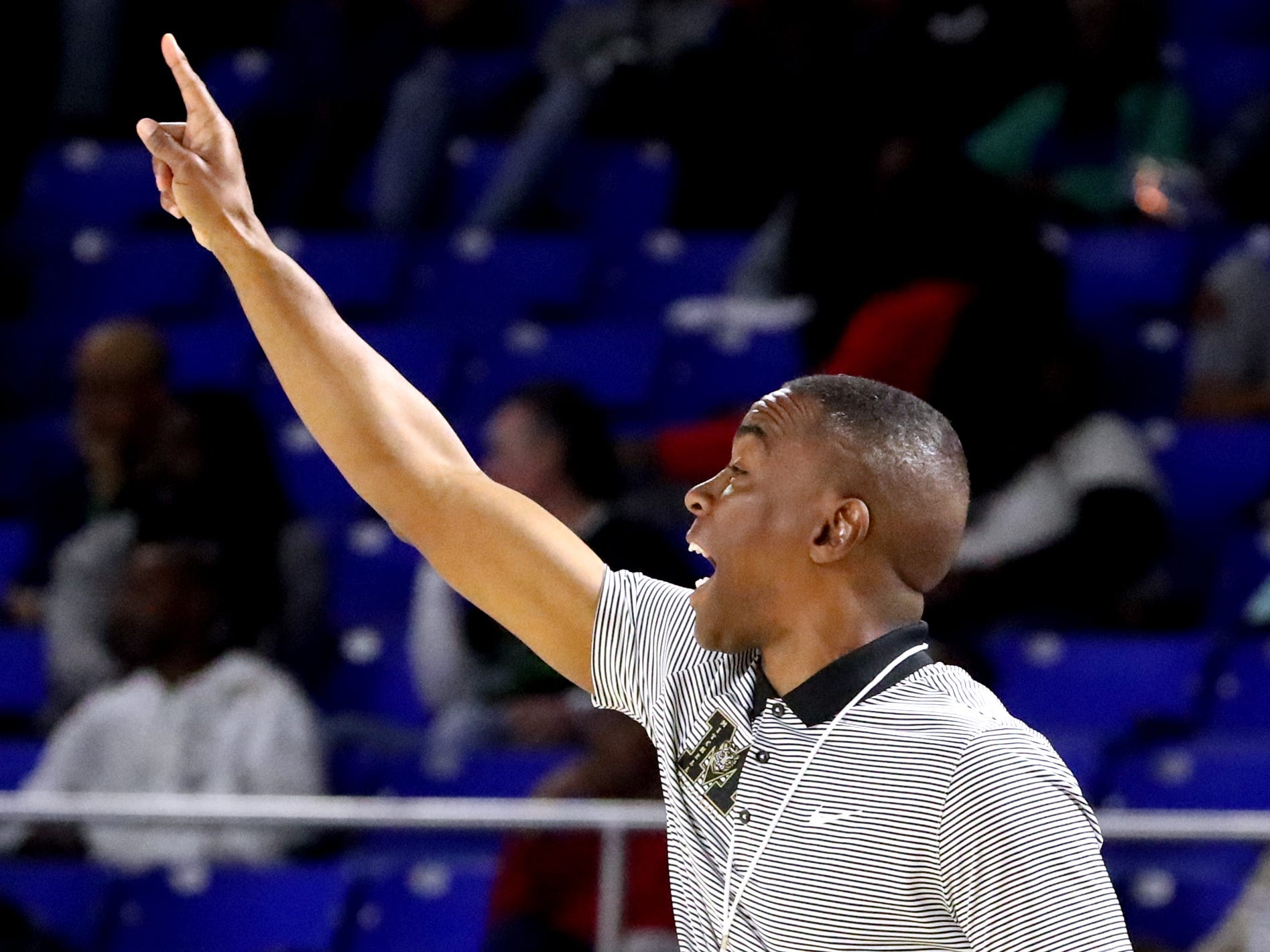 Mitchell's head coach Andre Turner on the sidelines during the quarterfinal round of the TSSAA Class AA Boys State Tournament against Fulton, on Wednesday, March 13, 2019, at Murphy Center in Murfreesboro, Tenn.