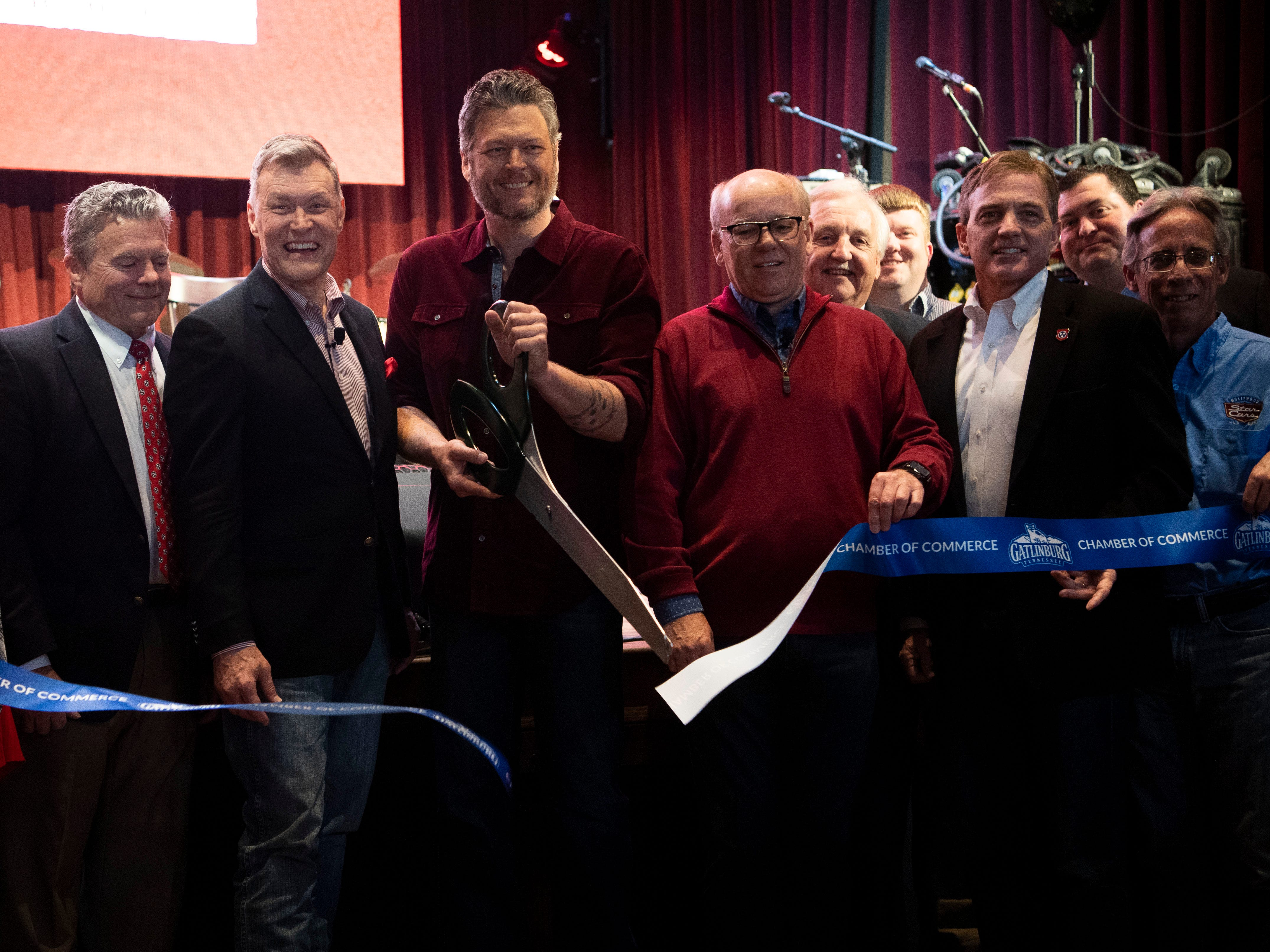 Blake Shelton cuts a ribbon to announce the grand opening of Ole Red Gatlinburg on Wednesday, March 13, 2019.
