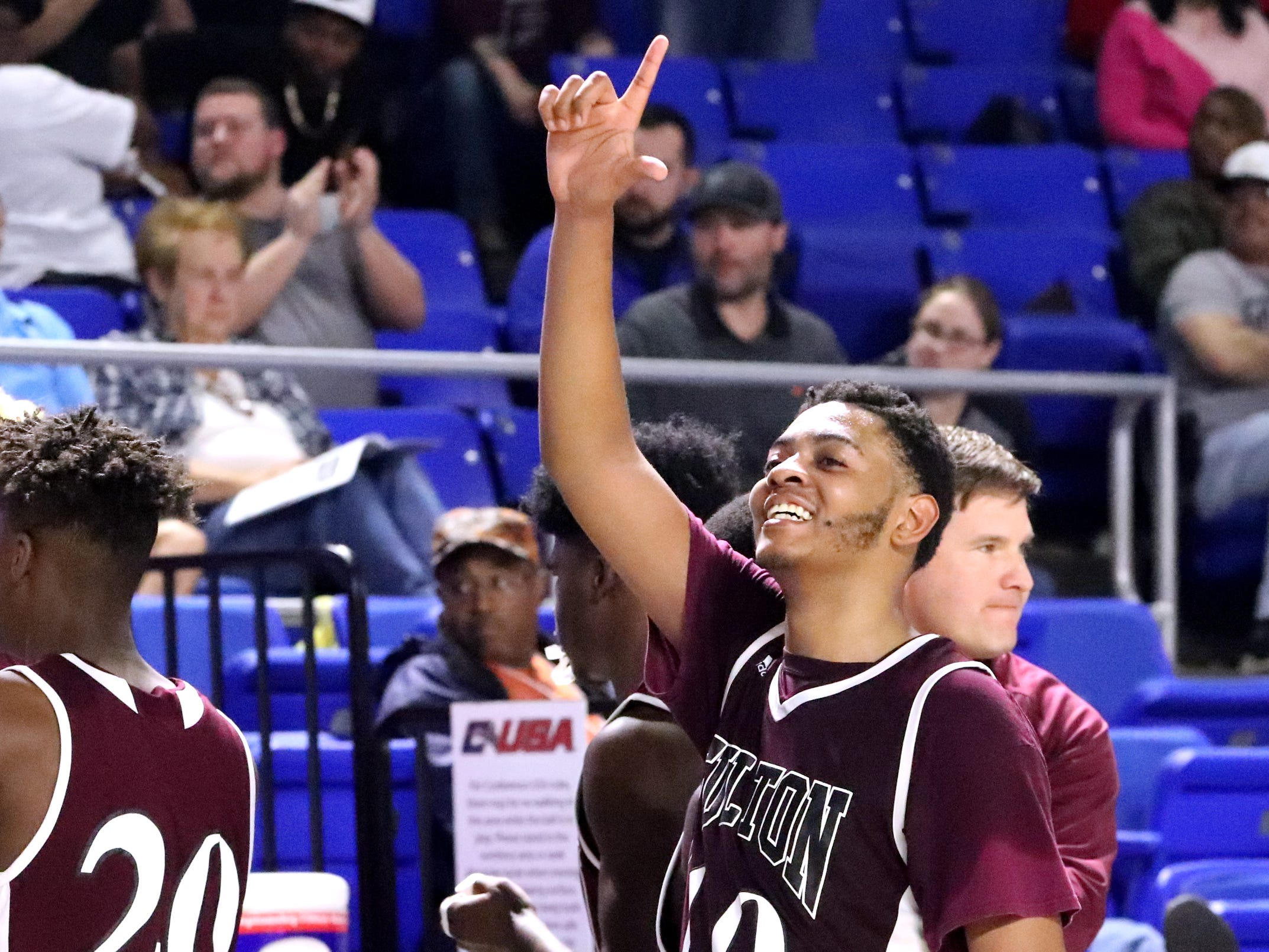 Fulton's Trey West (10) celebrates after beating Mitchell in over time in the quarterfinal round of the TSSAA Class AA Boys State Tournament, on Wednesday, March 13, 2019, at Murphy Center in Murfreesboro, Tenn.