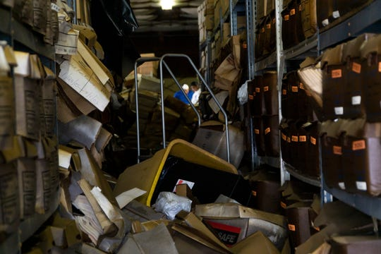 Water damaged records fill the isles of a warehouse storing paperwork in Knoxville. Water damaged reached several feet above the ground.