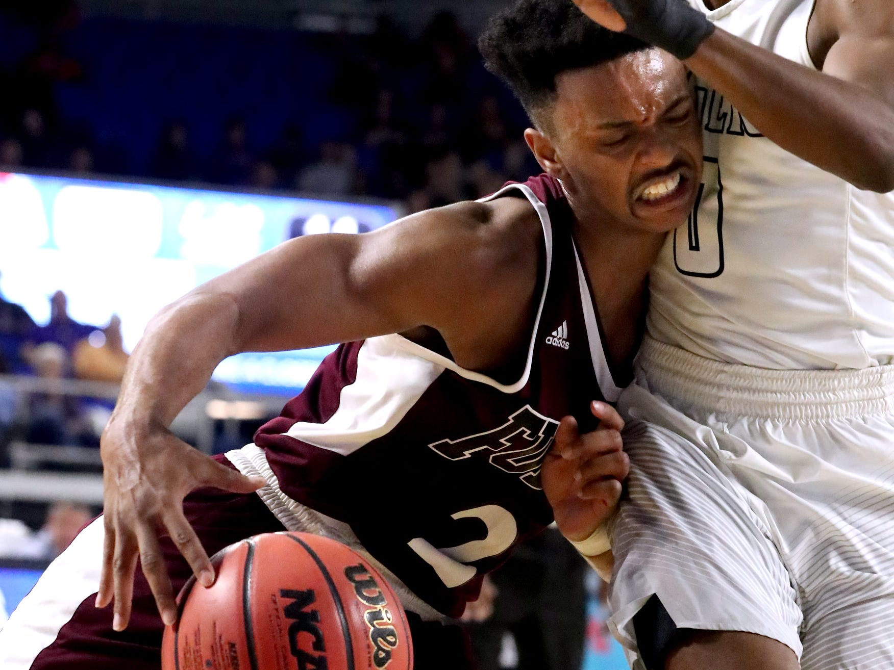 Fulton's Ron Davis III (2) drives to the basket as Mitchell's Michael Rice (0) guards him during the quarterfinal round of the TSSAA Class AA Boys State Tournament, on Wednesday, March 13, 2019, at Murphy Center in Murfreesboro, Tenn.