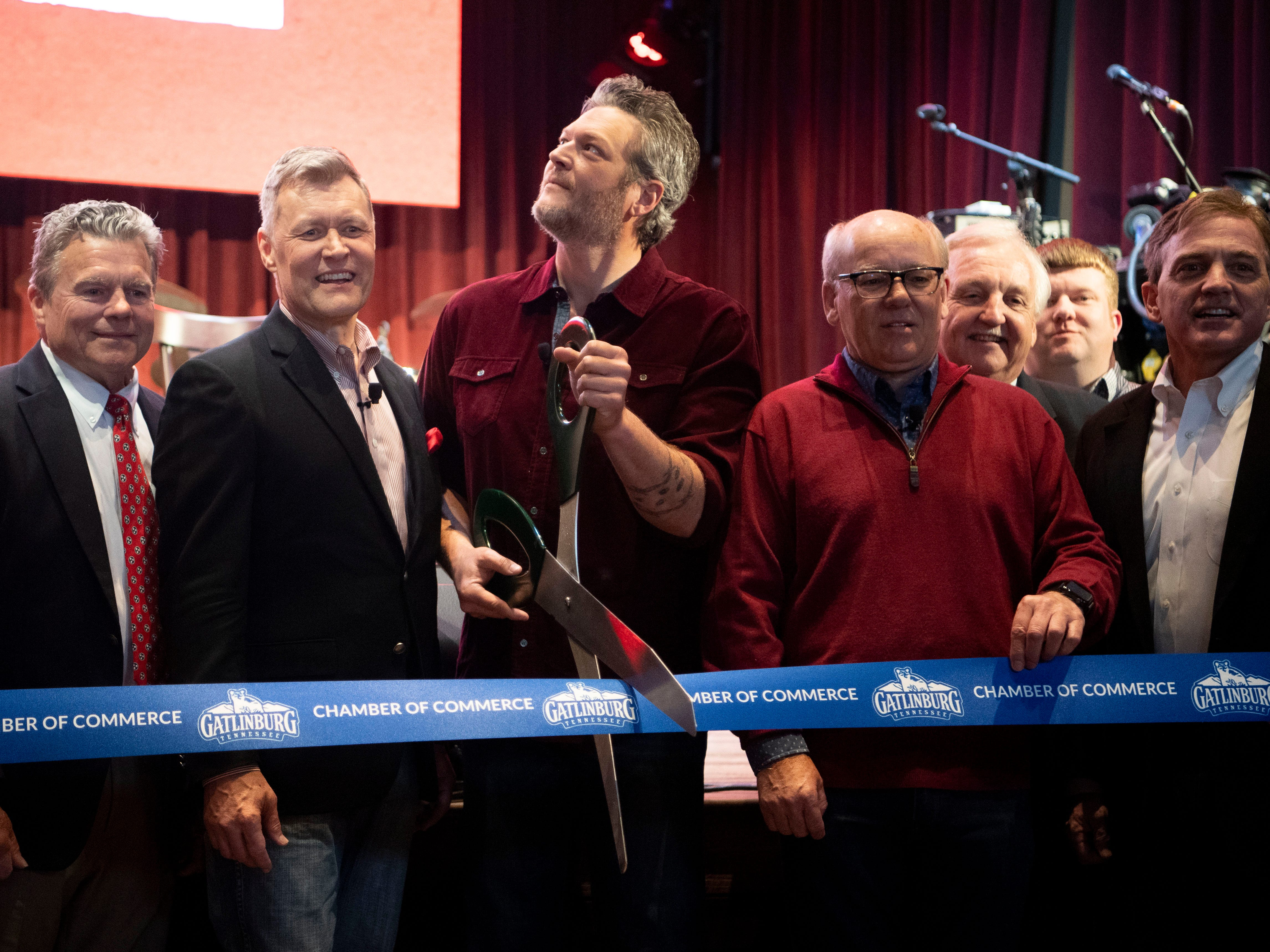 Blake Shelton is the guest of honor as he prepares to cut a ribbon to announce the grand opening of Ole Red Gatlinburg.