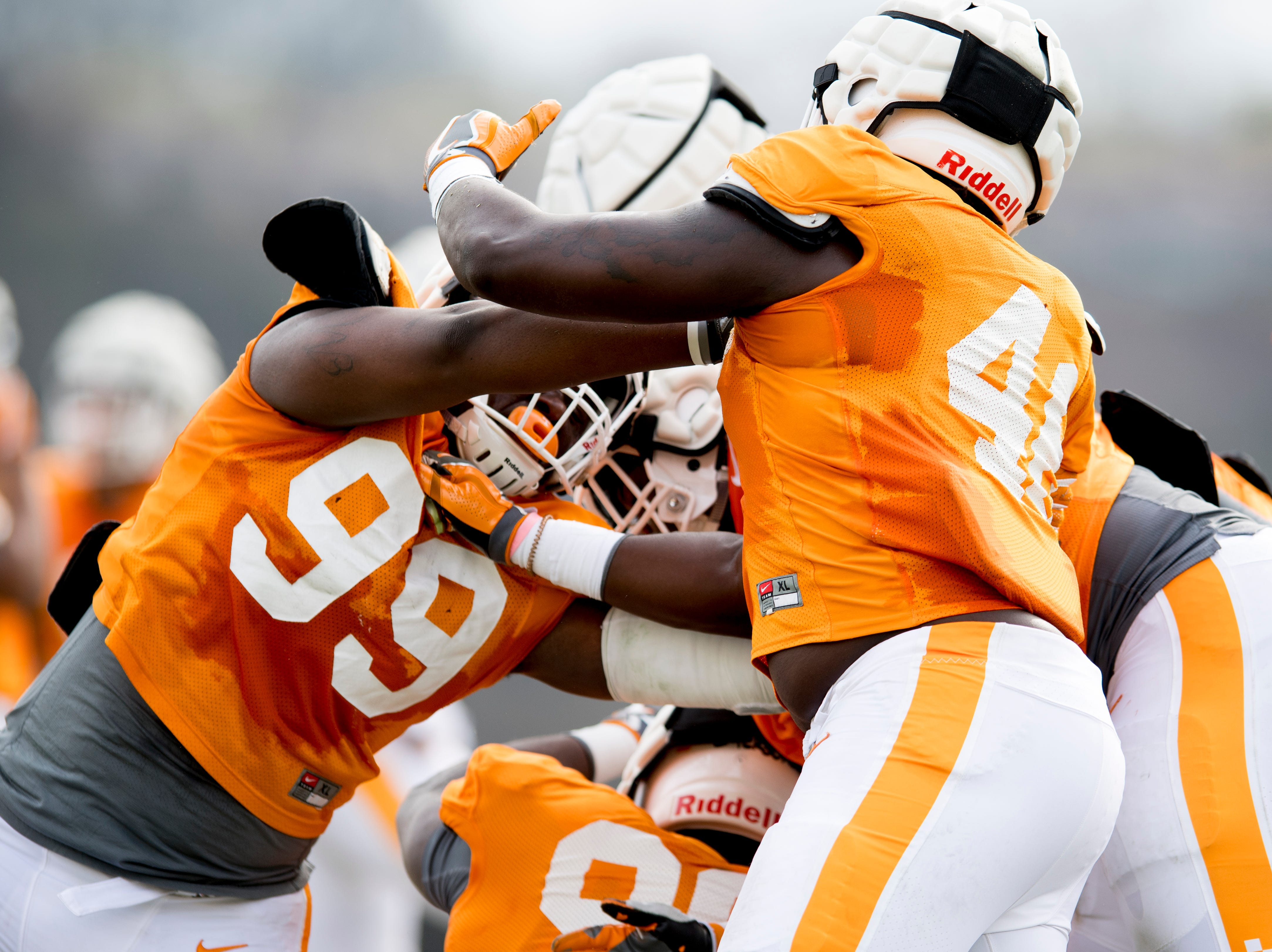 Tennessee defensive linemen John Mincey (99) and Kenneth George Jr. (41) drill together during Tennessee spring football practice at  Haslam Field in Knoxville, Tennessee on Wednesday, March 13, 2019.