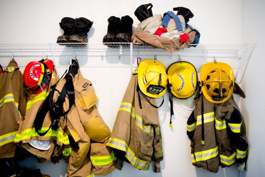 Helmets and jackets hang on a rack at the new Rural Metro Fire Station 36, 7615 Norman Jack Lane, in Powell, Tennessee on Wednesday, March 13, 2019. The station has been operational since early February and is hosting an open house and grand opening March 14 from 10am-7pm.