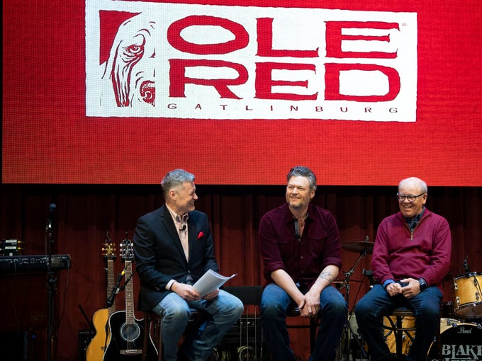 """Blake Shelton, center, along with Bill Cody of 650 AM WSM, left, and Ryman Hospitality Properties CEO Colin Reed hold a news conference on Wednesday, March 13, 2019 for the grand opening of Ole Red Gatlinburg and to kick off a weeklong series of """"Spring Blake"""" concerts and festivities."""