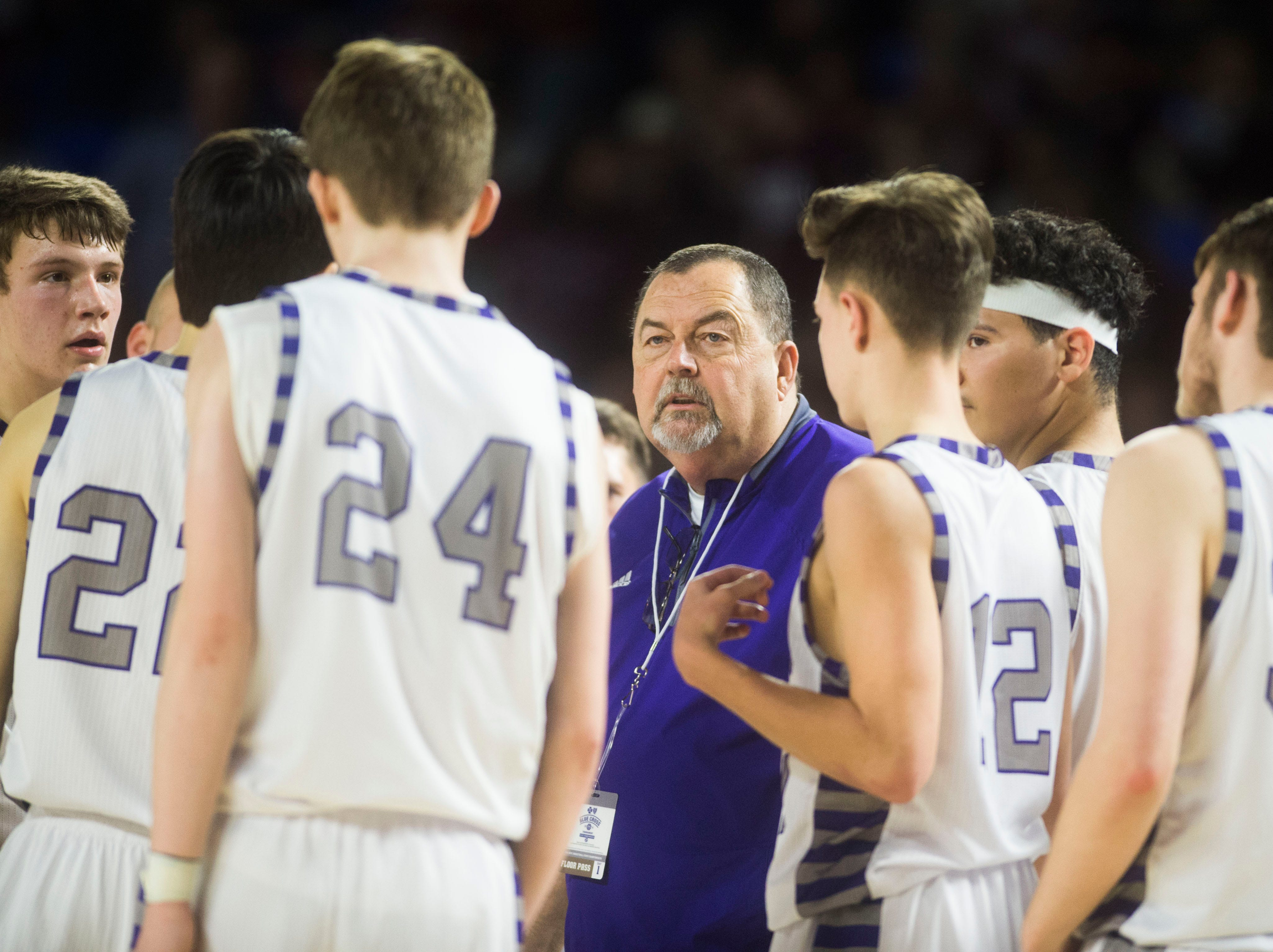 Sevier's head coach Ken Wright speaks to players during a TSSAA AAA state quarterfinal game between Sevier County and Whitehaven at the Murphy Center in Murfreesboro, Wednesday, March 13, 2019.