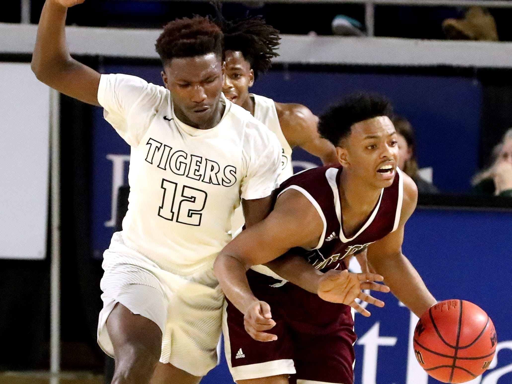 Mitchell's Phabian Dale (12) fouls Fulton's Ron Davis III (2) as he brings the ball up court during the quarterfinal round of the TSSAA Class AA Boys State Tournament, on Wednesday, March 13, 2019, at Murphy Center in Murfreesboro, Tenn.