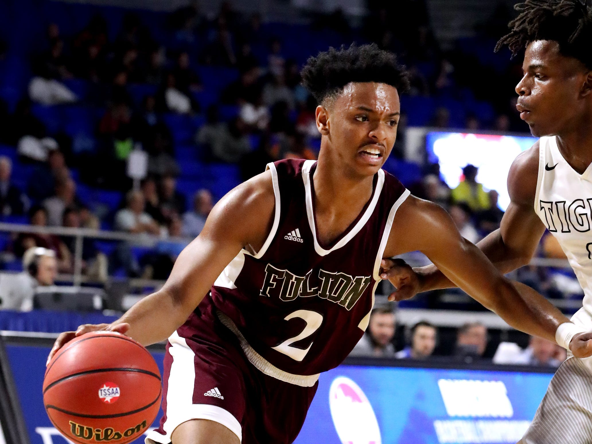 Fulton's Ron Davis III (2) drives to the basket around Mitchell's Michael Rice (0) during the quarterfinal round of the TSSAA Class AA Boys State Tournament, on Wednesday, March 13, 2019, at Murphy Center in Murfreesboro, Tenn.