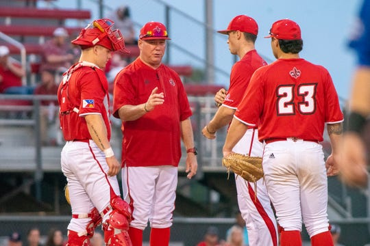 "UL's head baseball coach Tony Robichaux talks to his players on the mound as the Ragin' Cajuns take on the University of New Orleans Privateers at M.L. ""Tigue"" Moore Field on Tuesday, March 12, 2019."