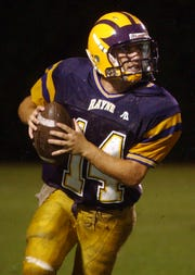 Kaine Guidry, a former Rayne High School football quarterback, has come full circle, having been named the Wolves' new head football coach.