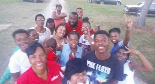 Pernell Boudreaux, with his friends and family. He was found dead on Saturday after neighbors heard gunfire.