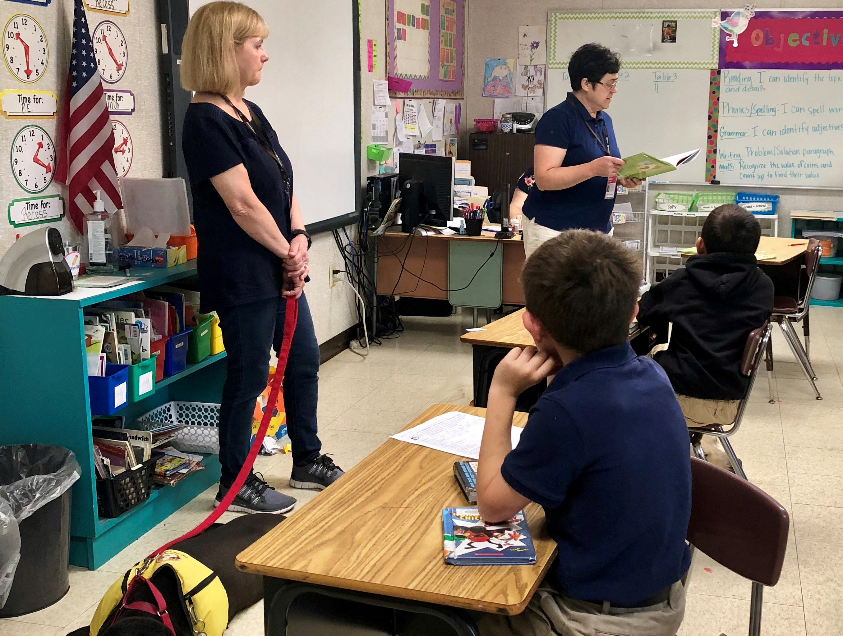 """Deborah Clothier reads to second-graders at Prairie Elementary School a story about adopting a dog at a shelter. """"Humane education"""" visits like the one Wednesday are funded through a grant from Cox Charities to Acadiana Animal Aid."""