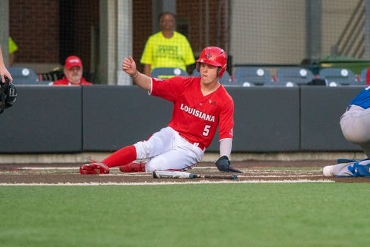 Shortstop Hayden Cantelle slides in with one of UL's three runs in its loss to UNO on Tuesday night.