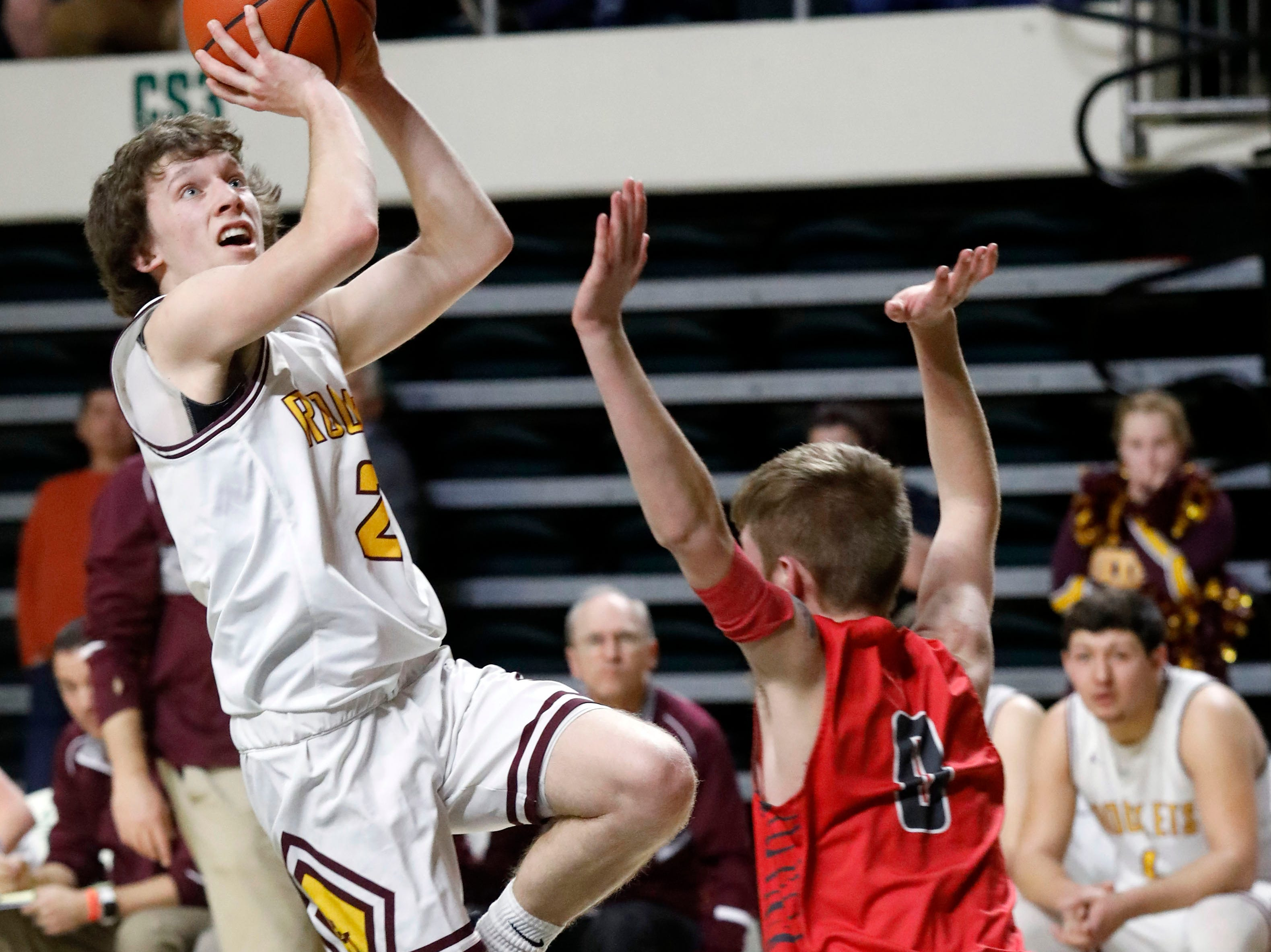 Berne Union's Chase McCartney takes a shot over Glenwood's Malachi Potts during Tuesday's Division IV Regional Semifinal game, March 12, 2019, at the Ohio University Convocation Center in Athens. The Rockets lost the 69-64.