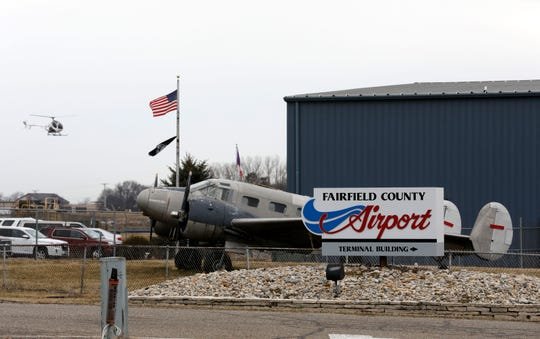 A helicopter comes in for a landing at the Fairfield County Airport Wednesday, March 13, 2019, in Lancaster. The airport will mark its 50th anniversary with a celebration May  18.
