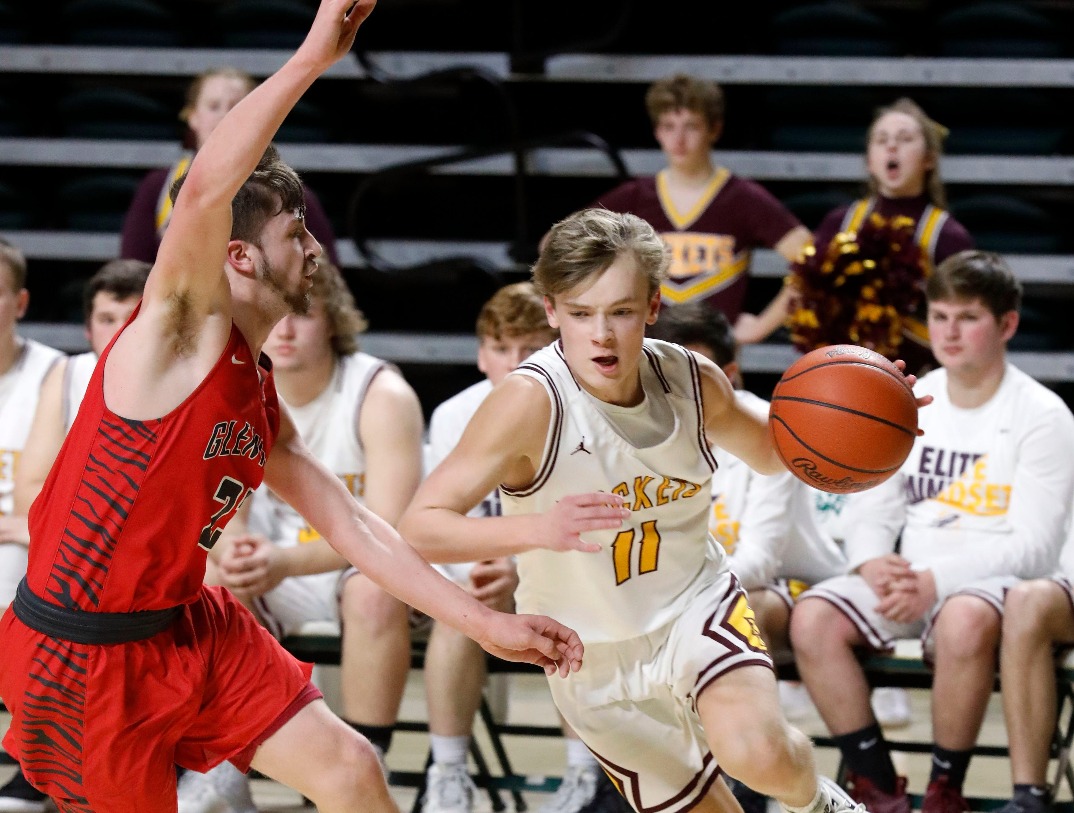 Berne Union's Jacob Harmon drives past Glenwood's Marcus Saunders during Tuesday's regional Semifinal game, March 12, 2019, at the Ohio University Convocation Center in Athens. The Rockets lost the game 69-64.