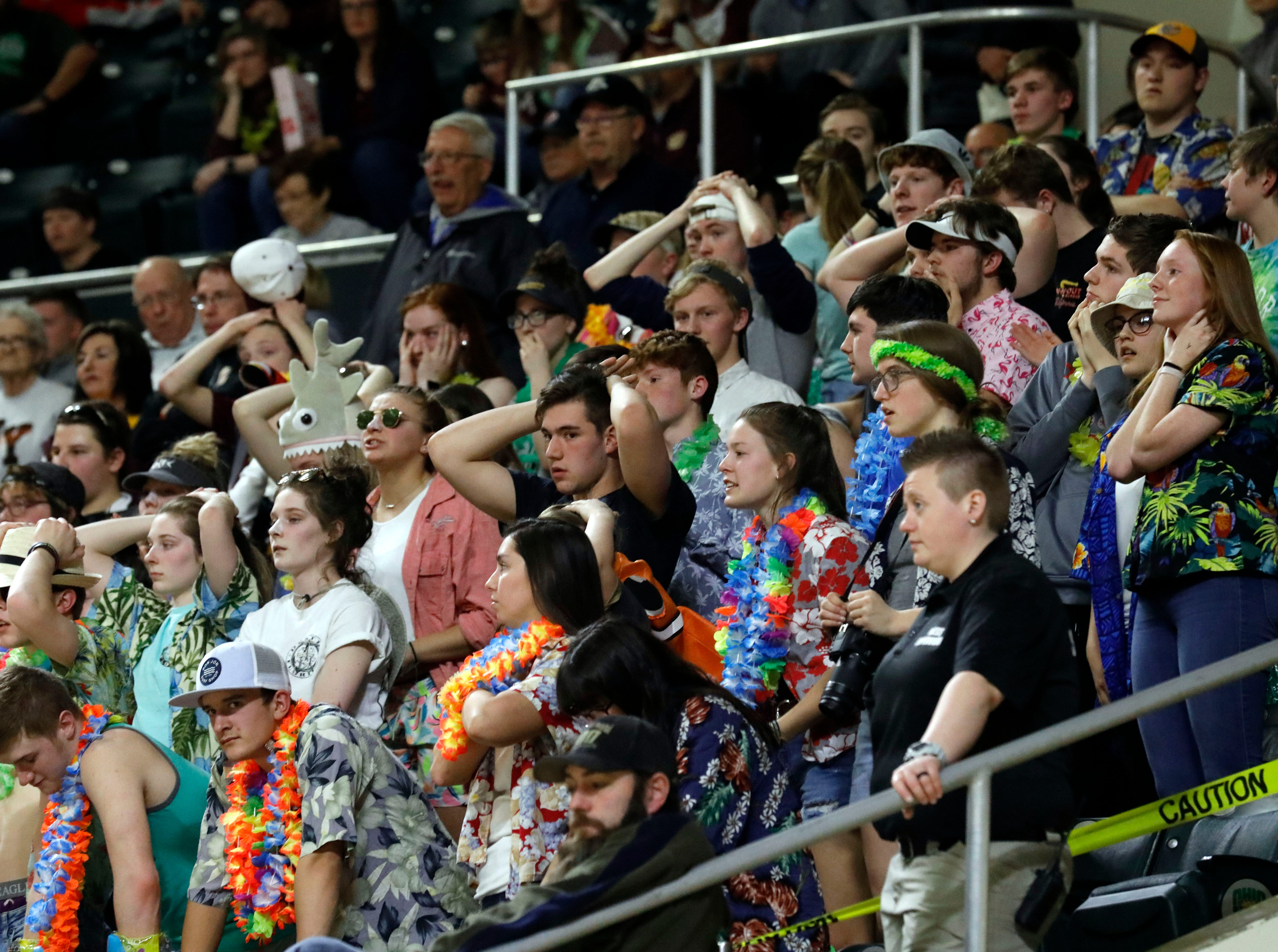 Berne Union students react as Glenwood extends its lead during the second half of a closely fought Division IV Regional Semifinal game Tuesday night, March 12, 2019, at the Ohio University Convocation Center in Athens. The Rockets lost the game 69-64.