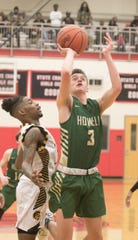 Howell's Kip French scores two of his 10 points in a 57-56 victory over Saginaw in the state basketball quarterfinals at Grand Blanc on Tuesday, March 12, 2019.