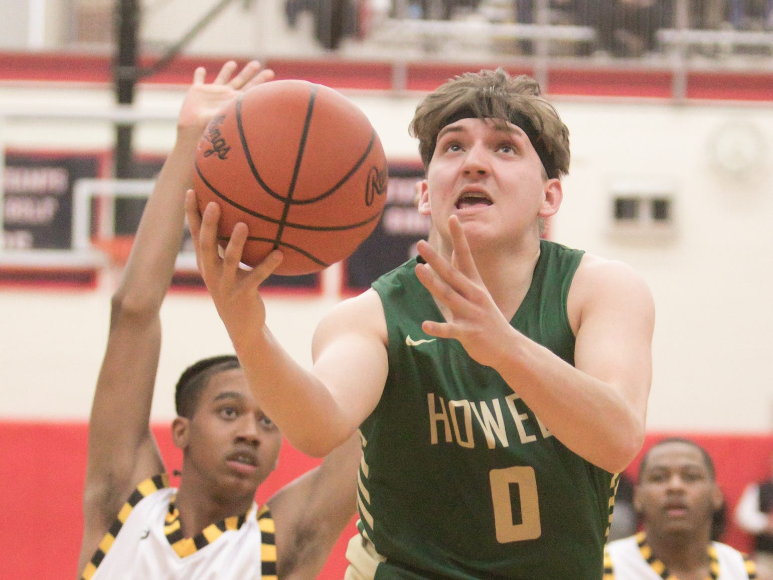 Howell's Josh Palo drives to the basket in a 57-56 victory over Saginaw in the state basketball quarterfinals at Grand Blanc on Tuesday, March 12, 2019.