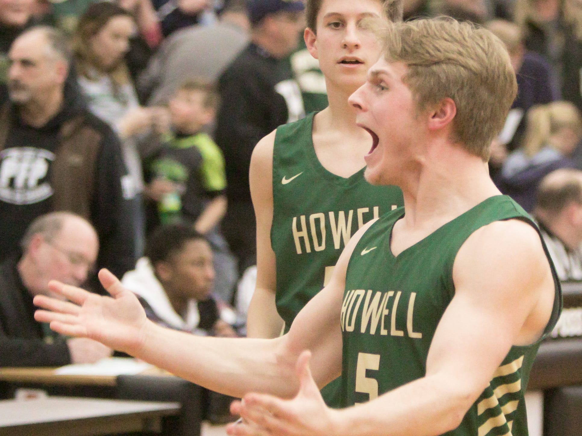 Howell's Peyton Ward (5) celebrates following a 57-56 victory over Saginaw in the state basketball quarterfinals at Grand Blanc on Tuesday, March 12, 2019.