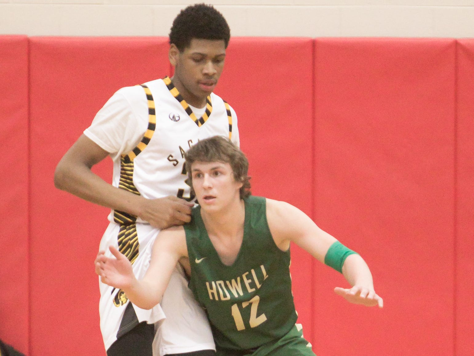 While Howell's Tony Honkala was dwarfed by Saginaw's James Baber, the Highlanders were not dominated in the quarterfinal game Tuesday, March 12, 2019, coming out on top.