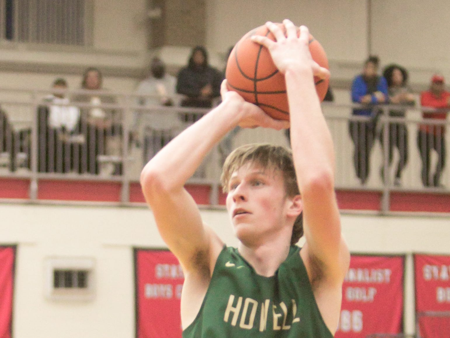 Howell's Cody Deurloo shoots in a 57-56 victory over Saginaw in a state basketball quarterfinal at Grand Blanc on Tuesday, March 12, 2019.
