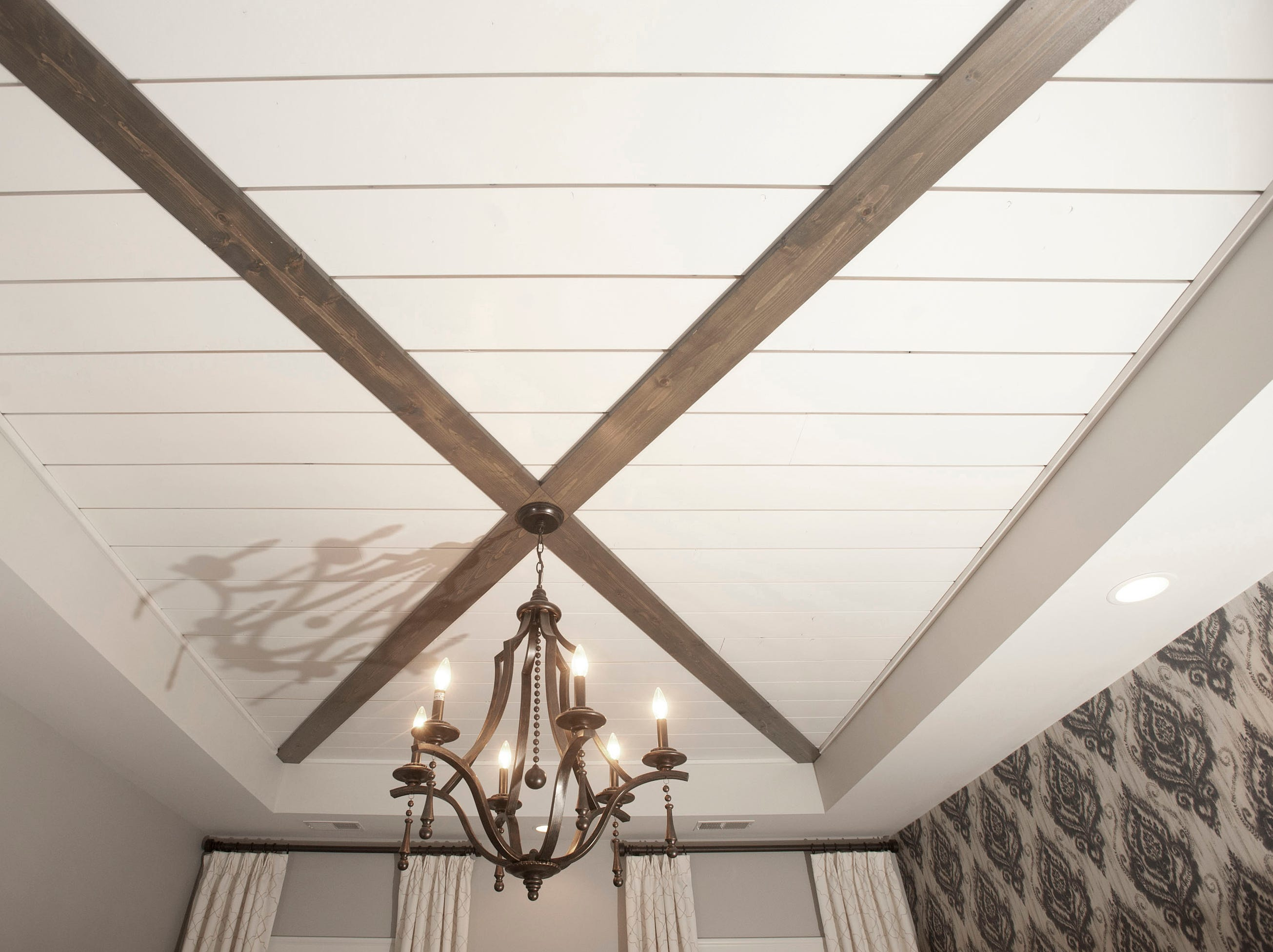 The Hannah master bedroom on the 2nd floor features a shiplapped trey ceiling with decorative wood crossbeams.01 March 2019