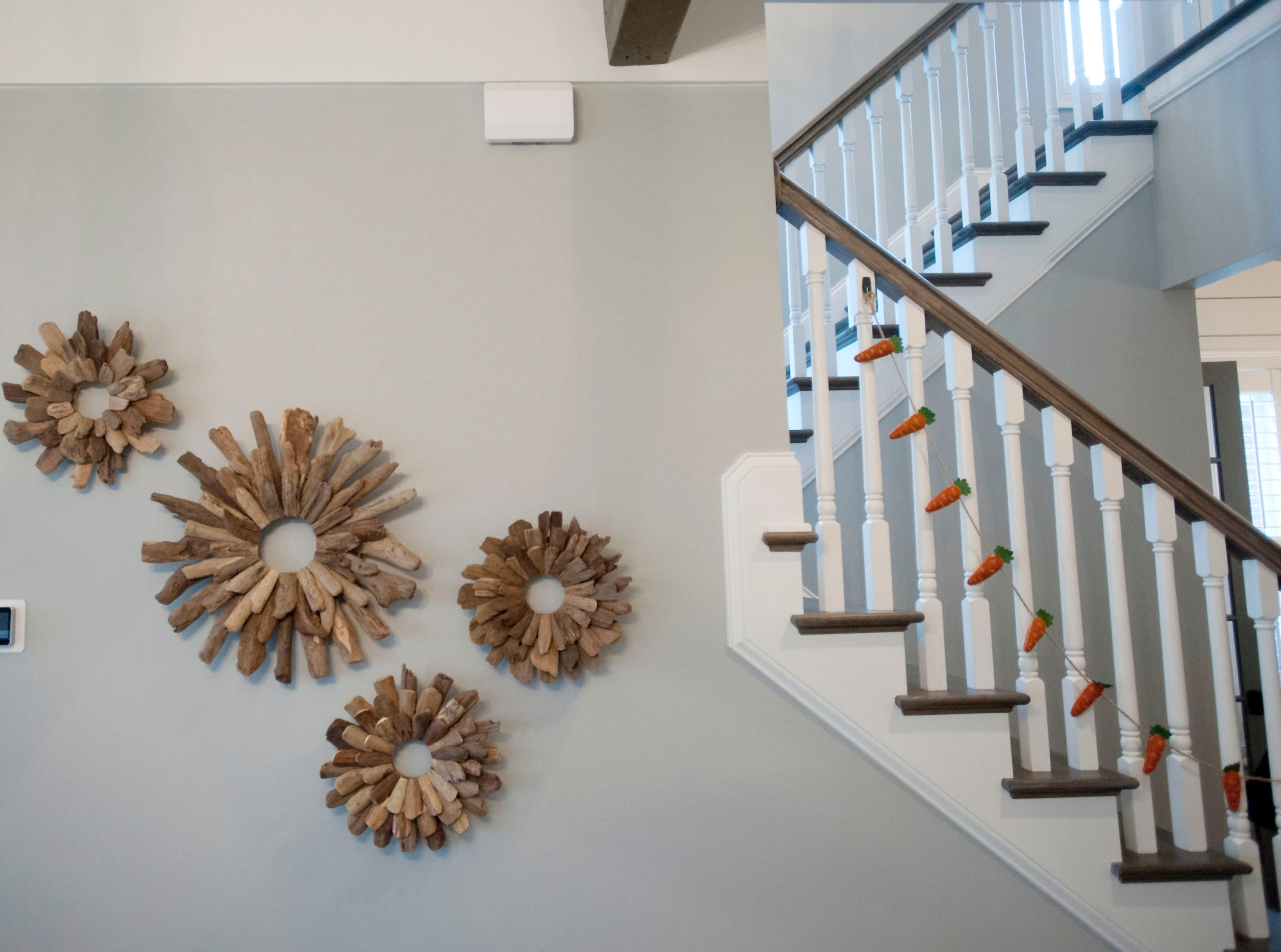 Wood circle sculptures decorate the first floor living room wall of the Hannah home in Norton Commons.01 March 2019