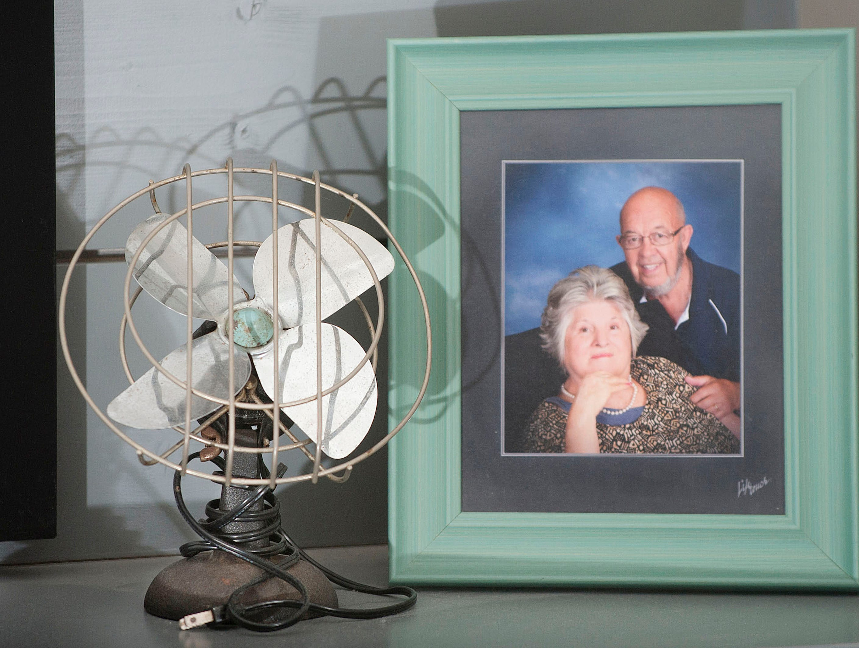 This antique fan sits in the basement family room, next to a portrait of its previous owners, Karista Hannah's grandmother and grandfather, Jack and Jeanette Graves.01 March 2019
