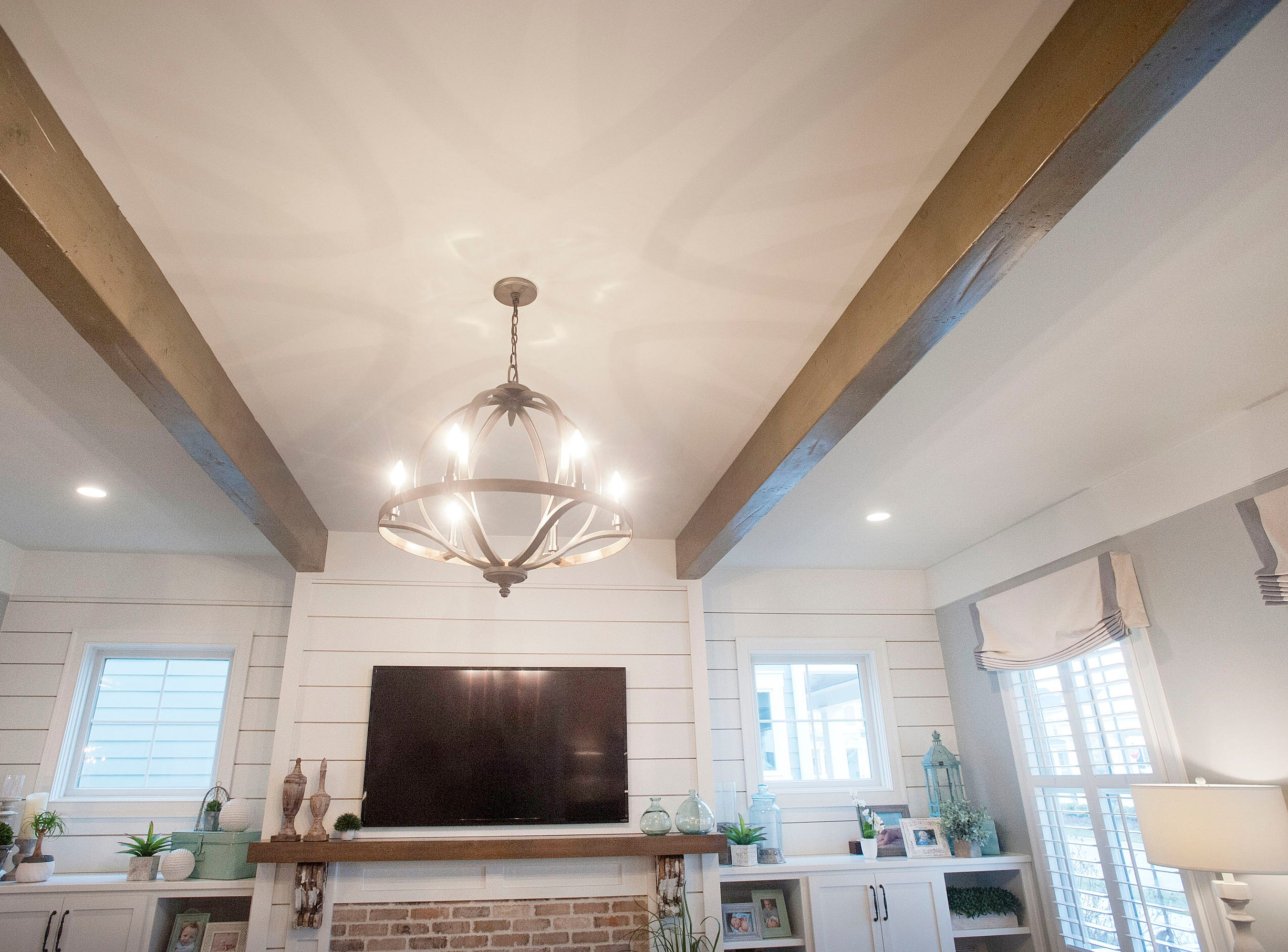 The Hannah living room features decorative wood beams.01 March 2019