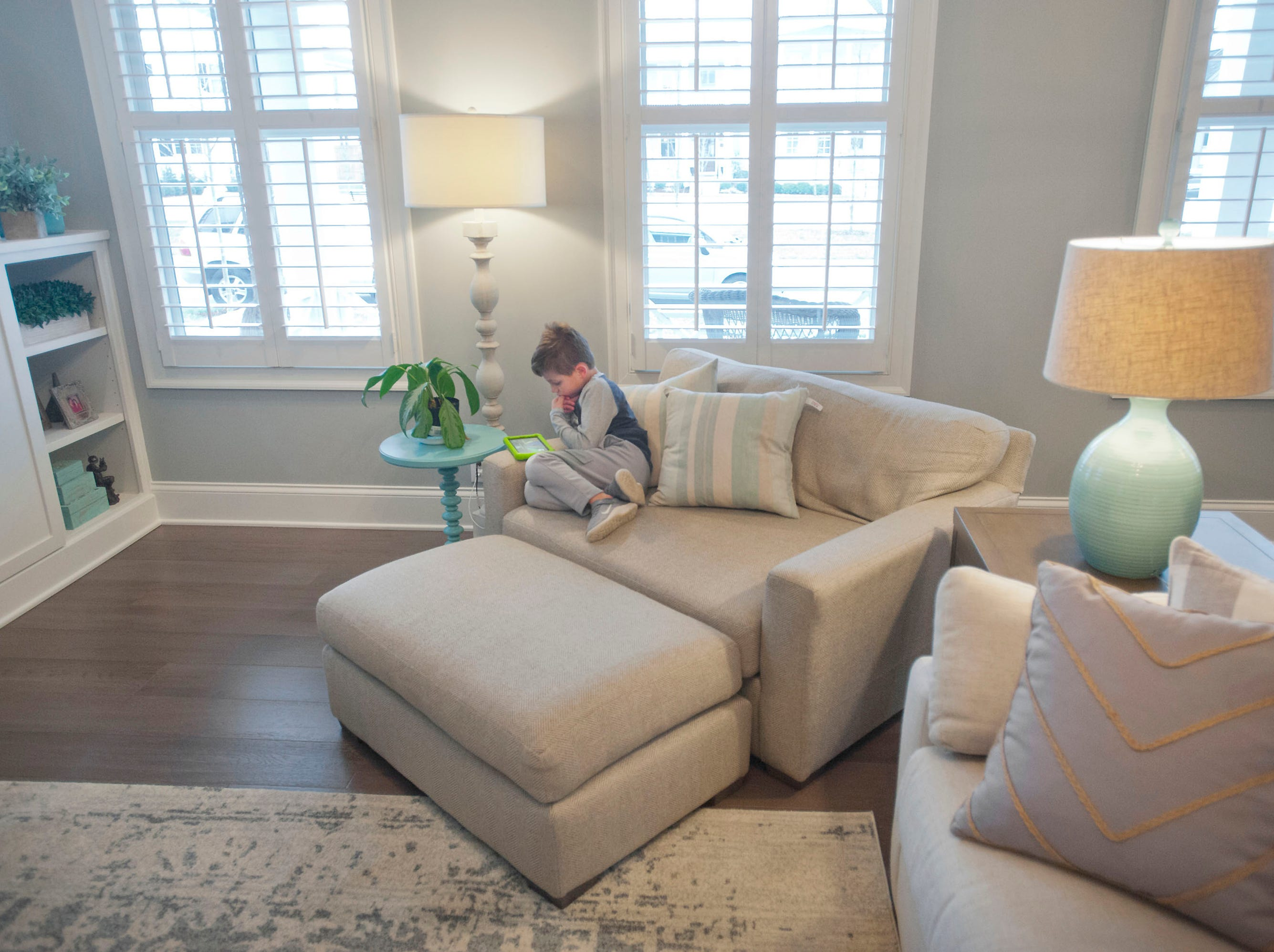 Ellis Hannah, age 5, plays on a game on his tablet in the living room.01 March 2019