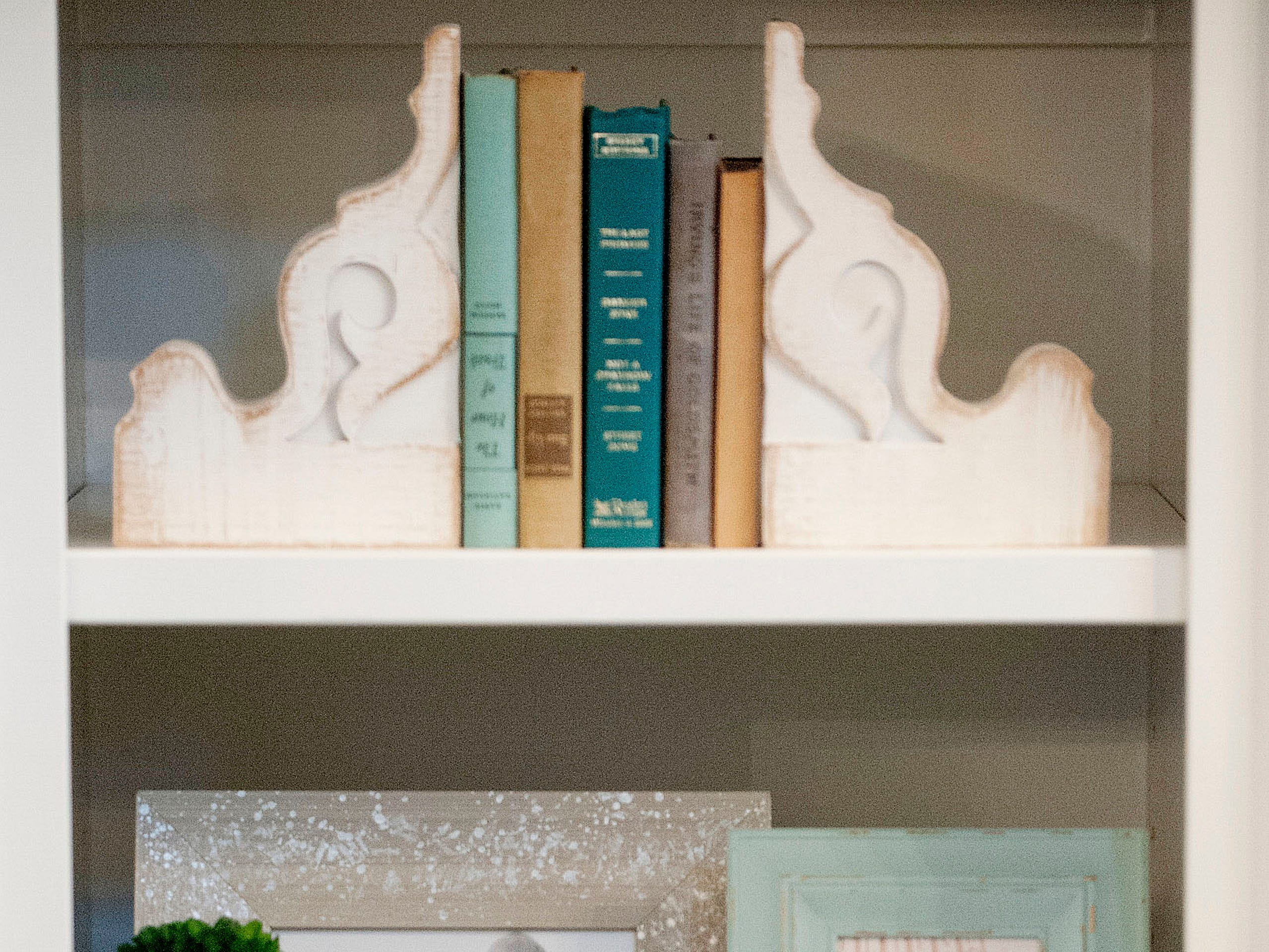 One of the built-in bookcases in the Hannah living room features family photos.01 March 2019