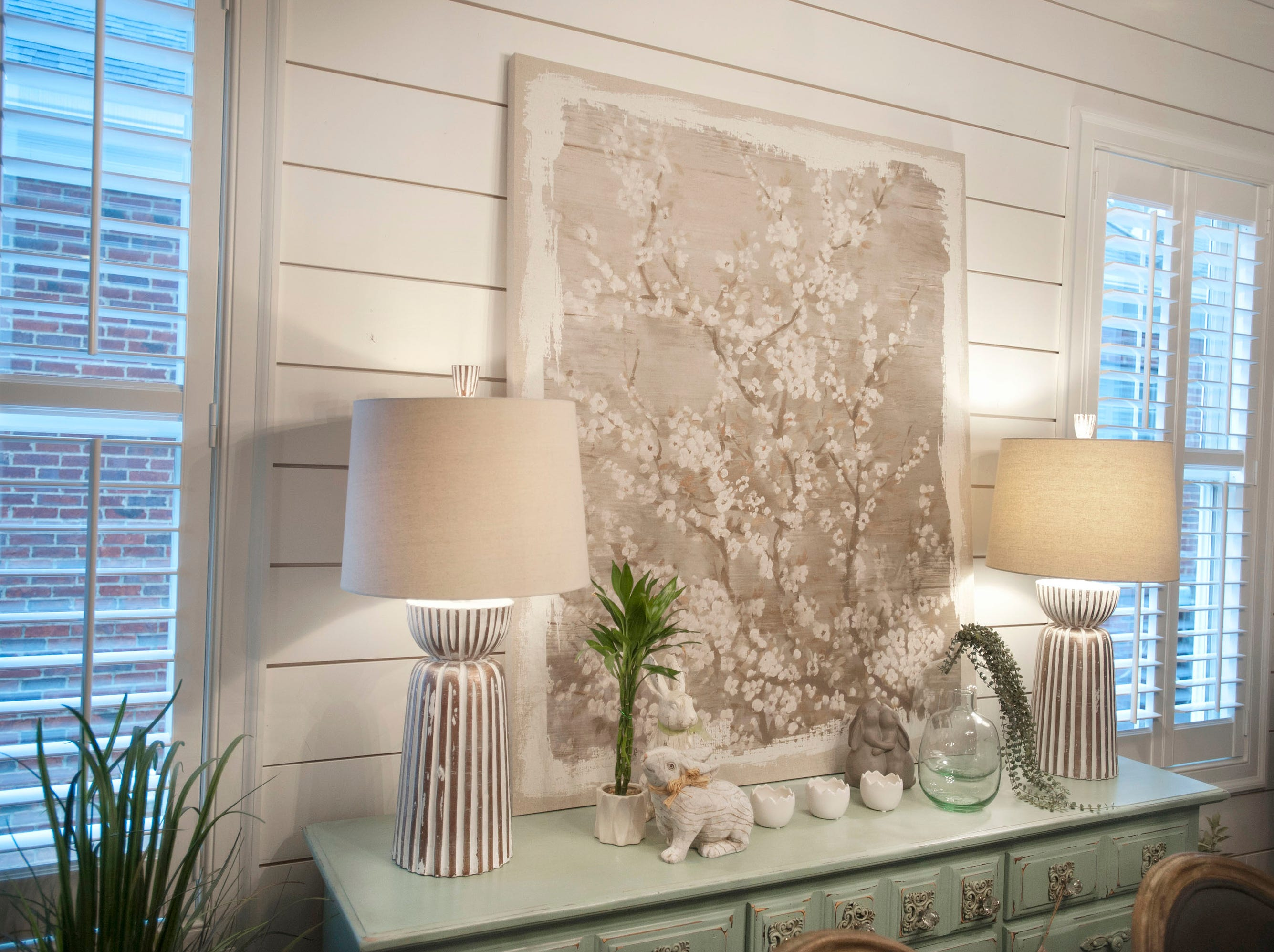 The wall of the Hannah dining room in Norton Commons, is decorated with shiplap, a feature found in several locations of the home.01 March 2019