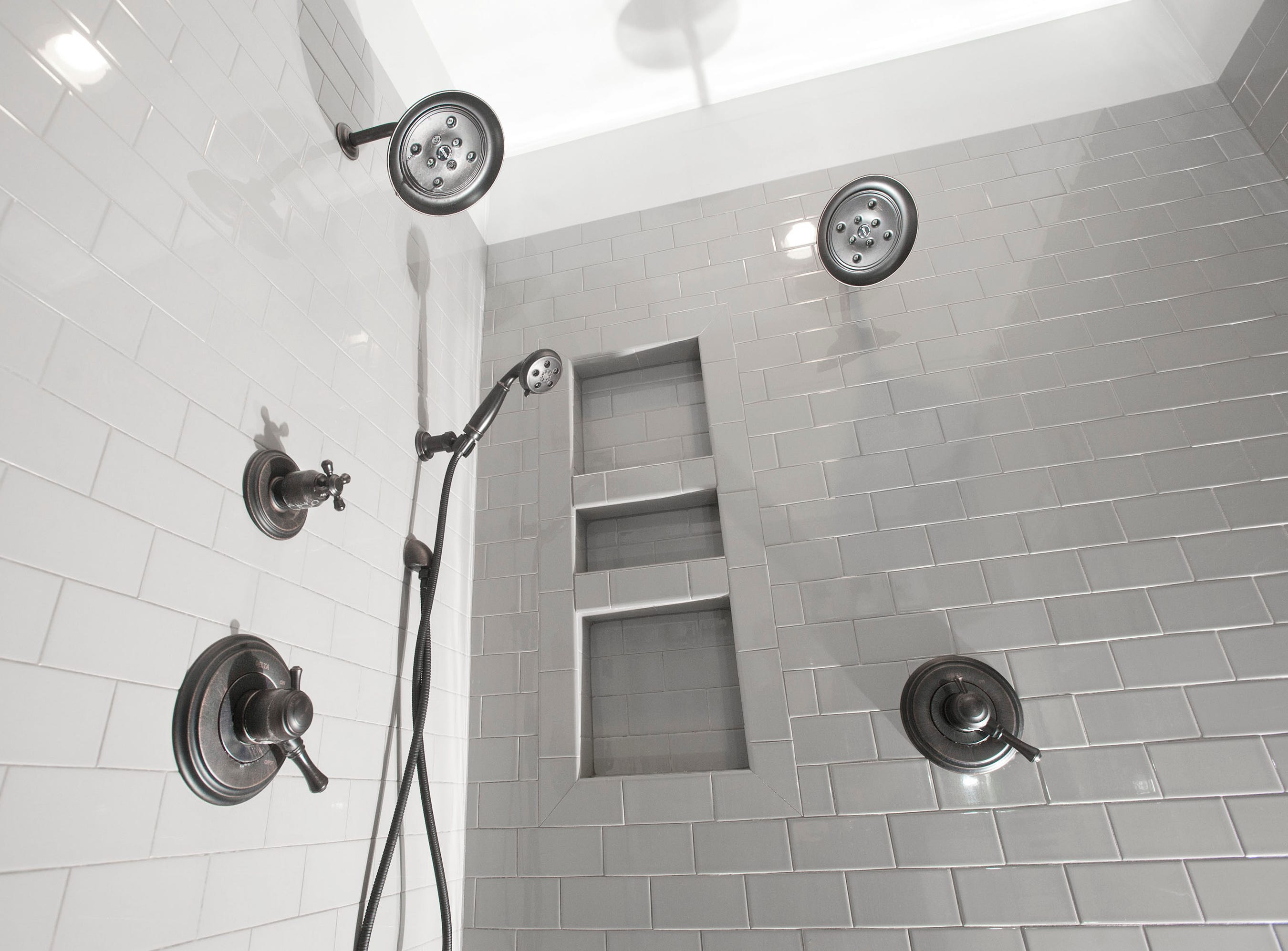 The master bathroom's subway tiled walk-in shower features  double shower and rain shower heads.01 March 2019