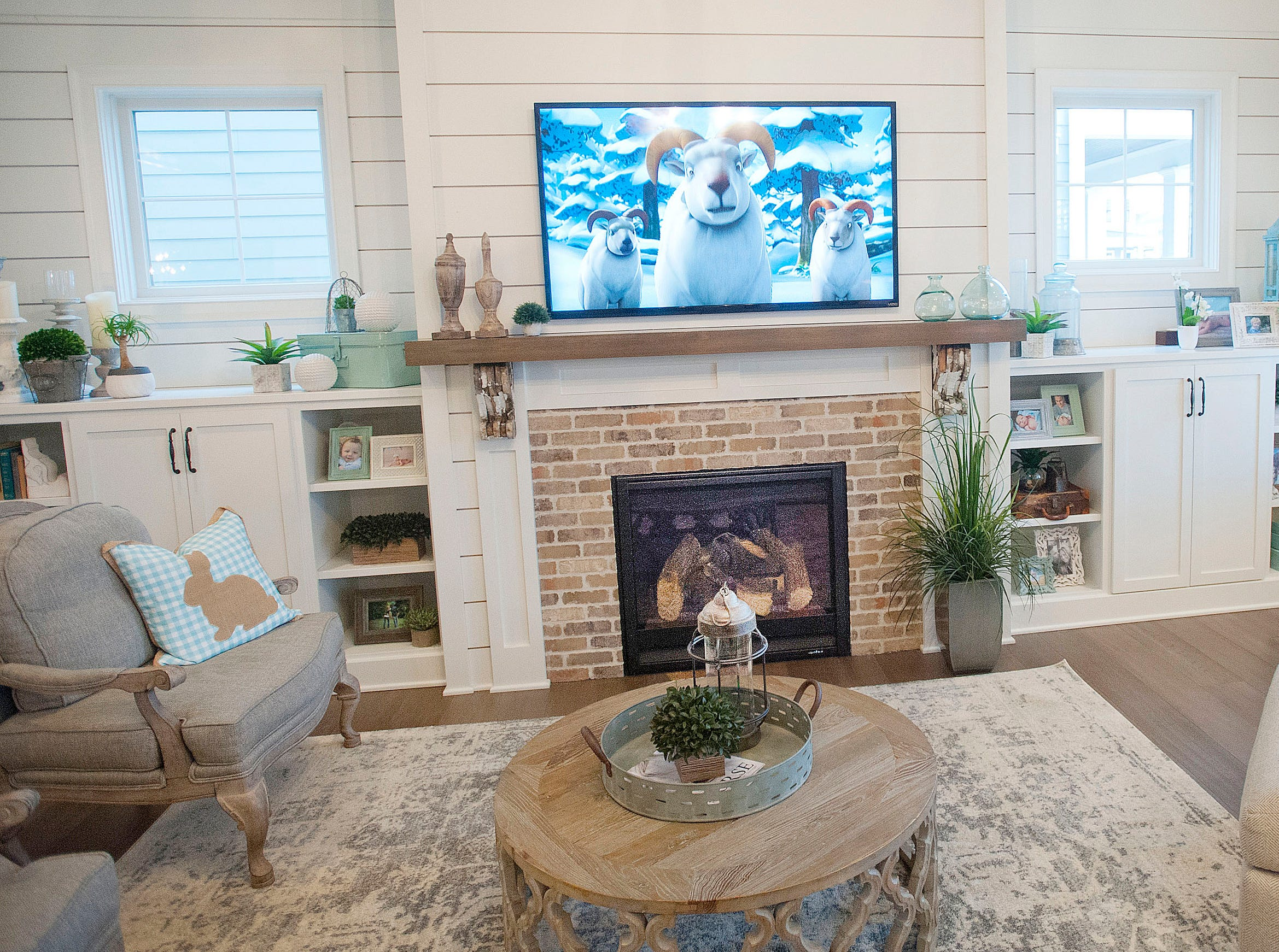 An animated movie plays on the television screen of the Hannah living room. The room wall is decorated with shiplap, as are other rooms in home.01 March 2019