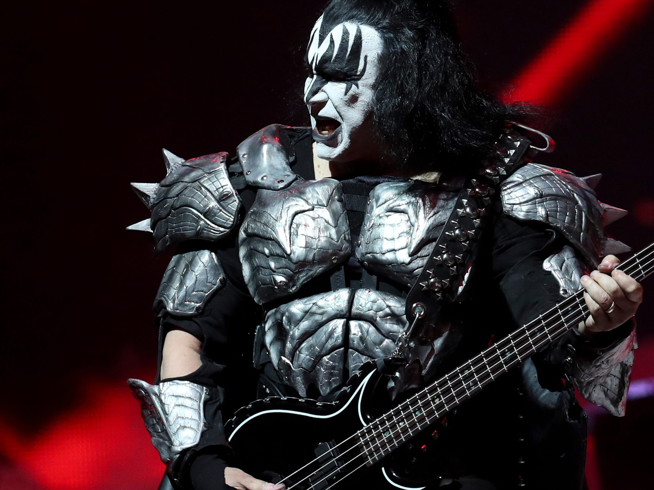 Gene Simmons of KISS entertains the crowd at the KFC Yum Center on March 12.