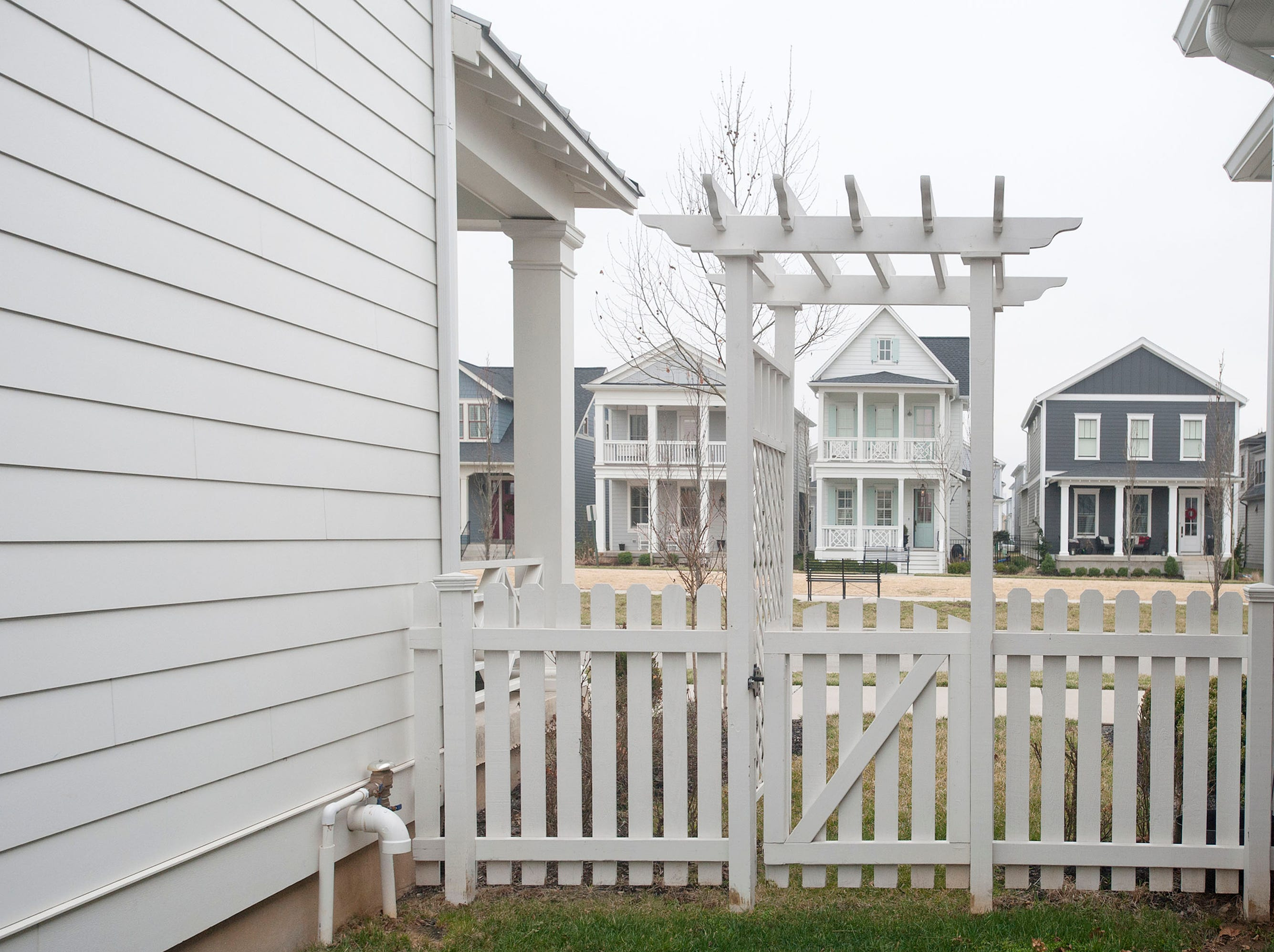 An arbor and picket fence separates the Hannah home (left) from its neighbor's in Norton Commons. 01 March 2019
