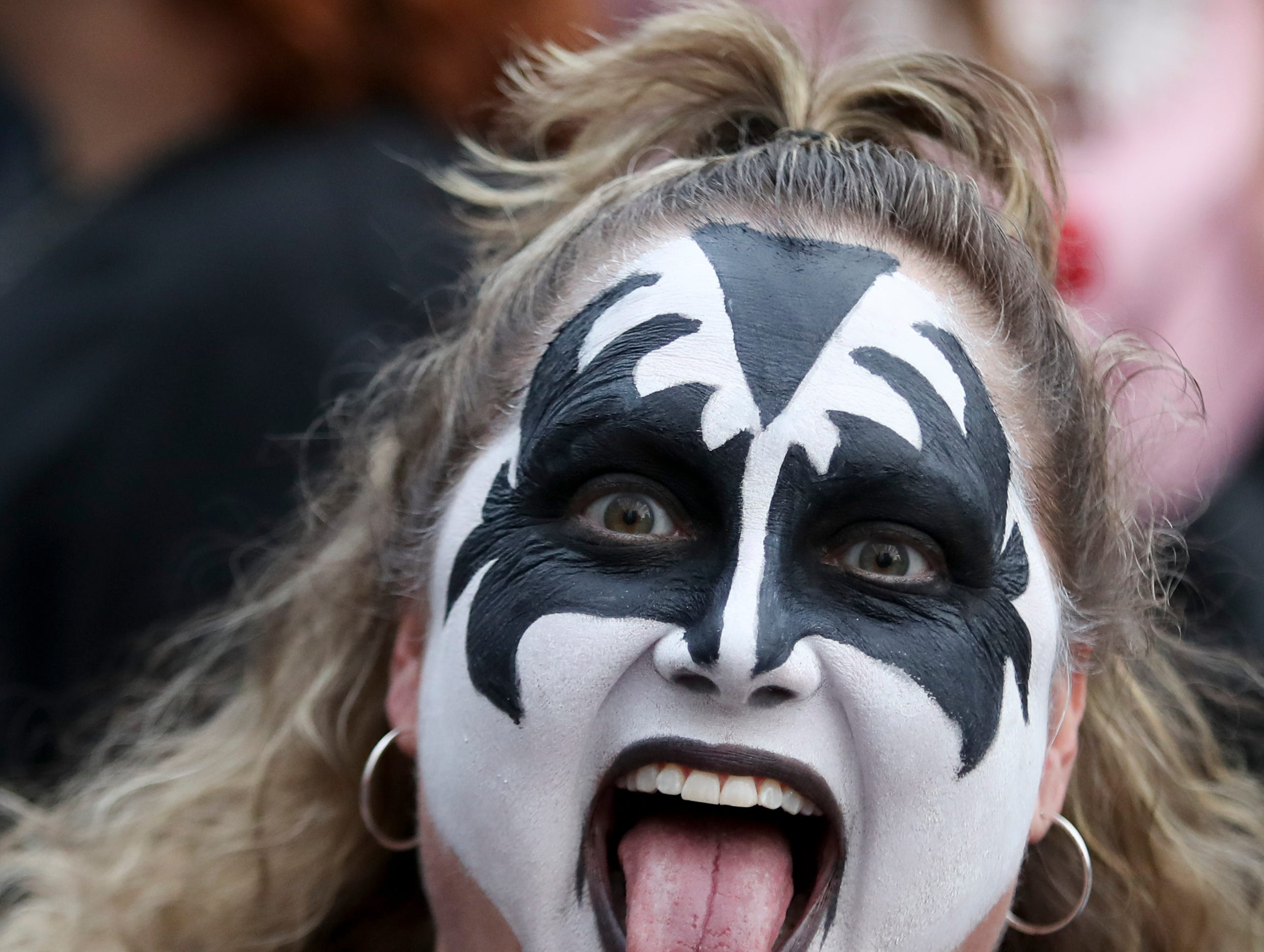 Fans of the band KISS show up at the KFC Yum Center on March 12 dressed to impress.