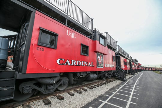 The Cardinal Express cabooses sit behind Cardinal Stadium. 