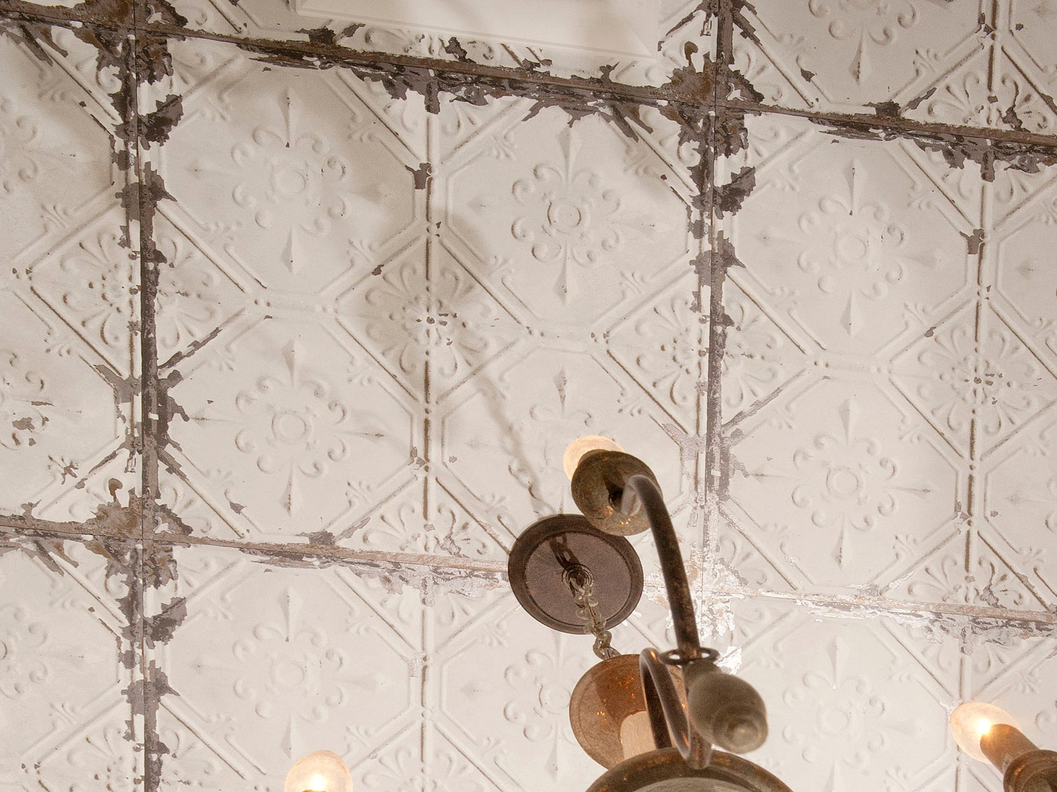 The Hannah's first floor bathroom features wallpaper that resembles antique tin ceiling tiles.01 March 2019