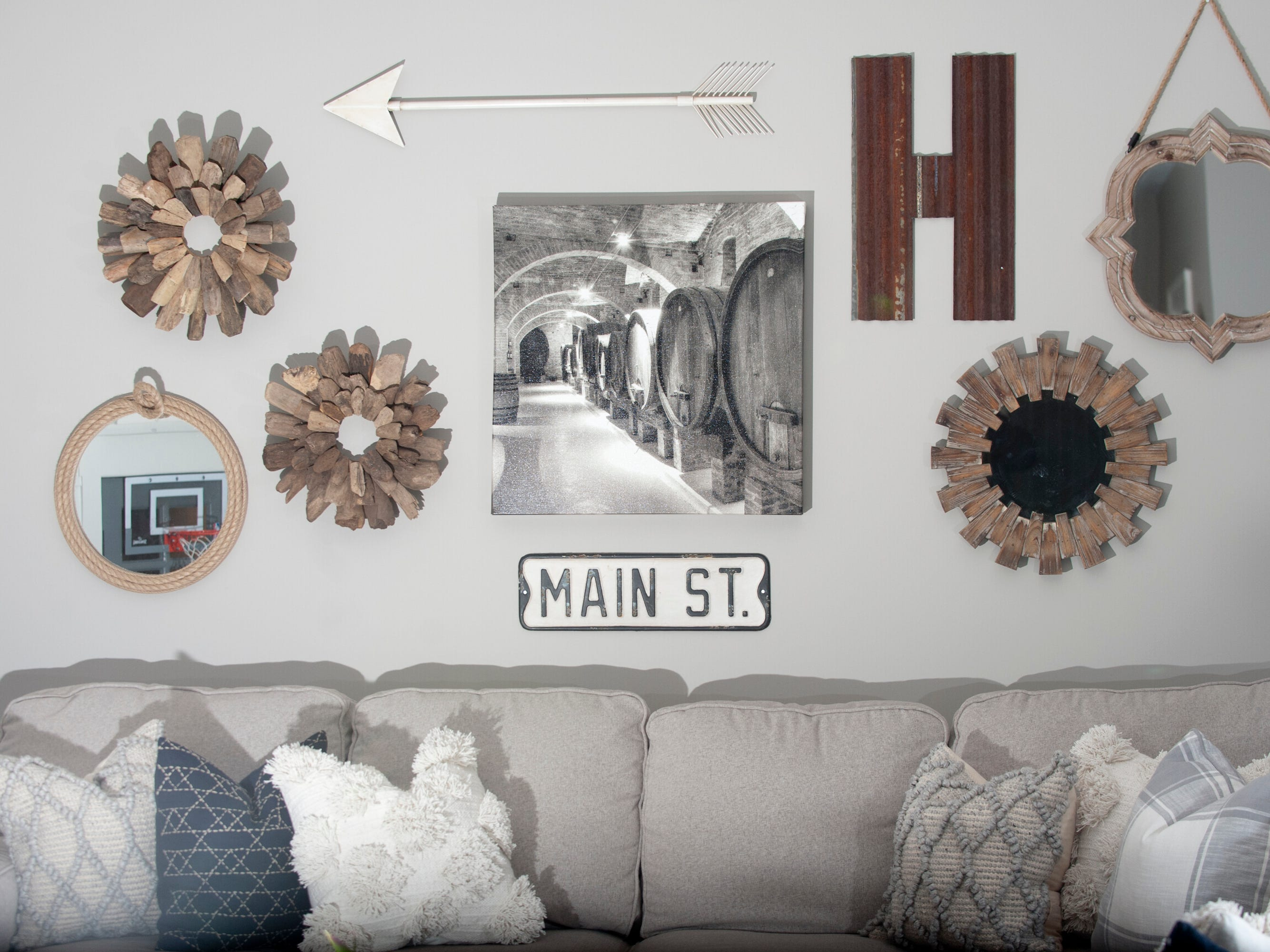 The Hannah basement family room wall includes a tin roof shingle shaped into an H (for Hannah,) a gift the Hannah' aunt Jenny. Karista Hannah chose the Main Street sign because it reminded her of biking up and down the street when she was growing up in her home town of Elizabeth, Illinois.01 March 2019
