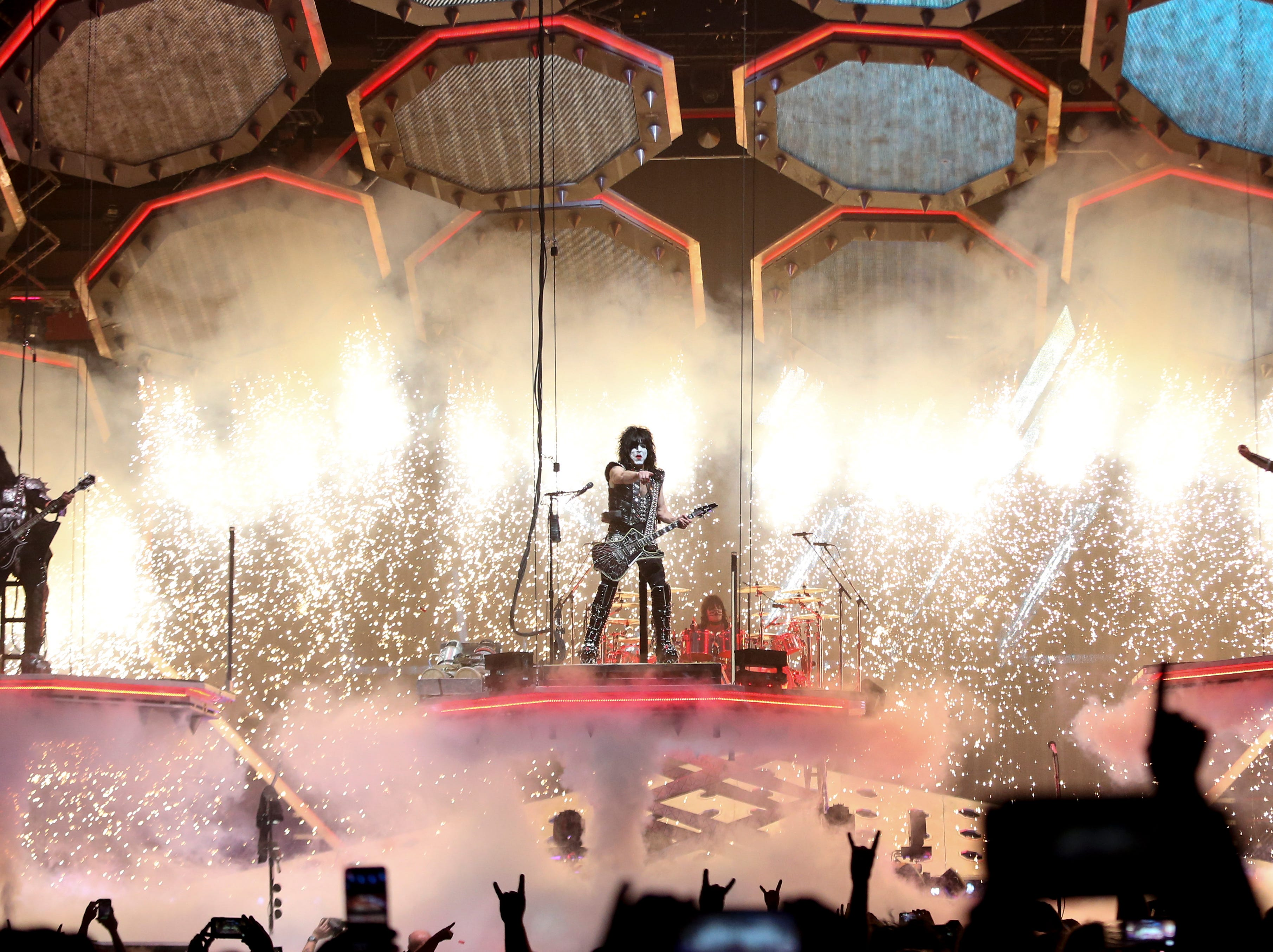 Gene Simmons, Paul Stanley and Tommy Thayer of KISS are lowered to the stage at the KFC Yum Center on March 12.