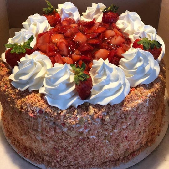 Strawberry Shortcake Crunch, is a popular cheesecake at Everything is Cheesecake. It's topped with strawberry cake that has a crunch topping along the sides.