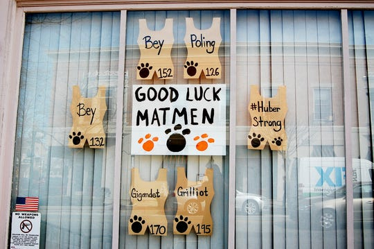 The storefronts in the village support high school athletics team with construction paper signs on Tuesday, March 12, 2019, in Versailles, Ohio.