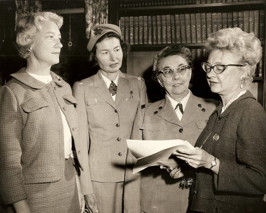 Girl Scout officials accepting Spindler home as Manitou Girl Scout Council office. Pictured, from left, are Mrs. Edmun Knauf, Mrs. George Platt, Mrs. Henry Mieselwitzand Mrs. John Torrison.