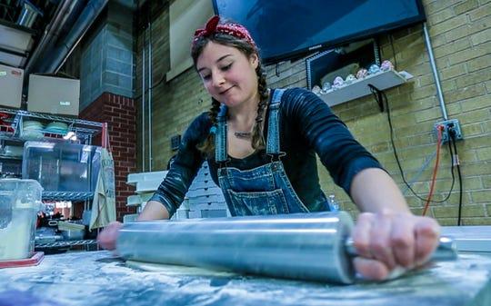 Hannah Frank rolls a pizza dough Thursday, Feb. 21, 2019, at Marilyn's Fire Station & Catering in Medford.